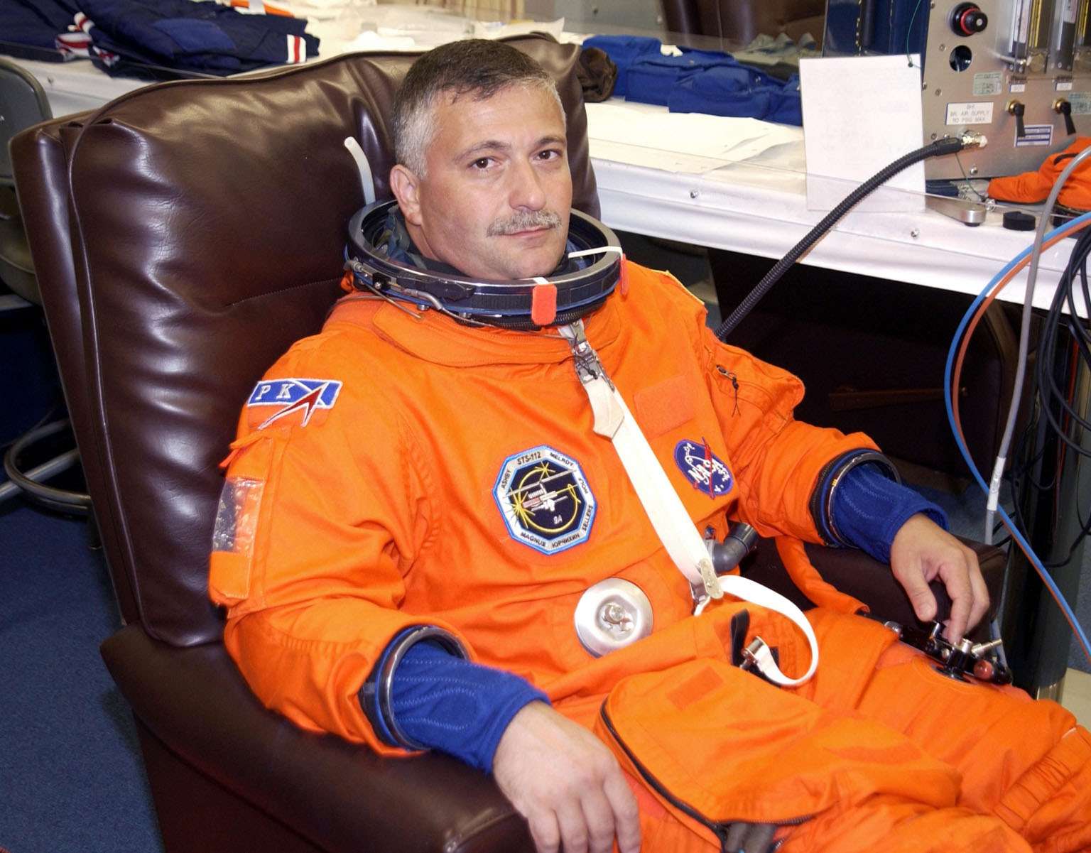 KENNEDY SPACE CENTER, FLA. -- STS-112 Mission Specialist Fyodor Yurchikhin has his launch and entry suit checked for fit in preparation for launch. The suit check is part of Terminal Countdown Demonstration Test activities, which also include emergency egress training and a simulated launch countdown. The mission aboard Space Shuttle Atlantis is scheduled to launch no earlier than Oct. 2, between 2 and 6 p.m. EDT. STS-112 is the 15th assembly mission to the International Space Station. Atlantis will be carrying the S1 Integrated Truss Structure, the first starboard truss segment. The S1 will be attached to the central truss segment, S0, during the 11-day mission. Yurchikhin will assist Pilot Pamela Melroy in preparing the spacewalk hardware for the three scheduled EVAs. STS-112 is Yurchikhin's first Shuttle flight.