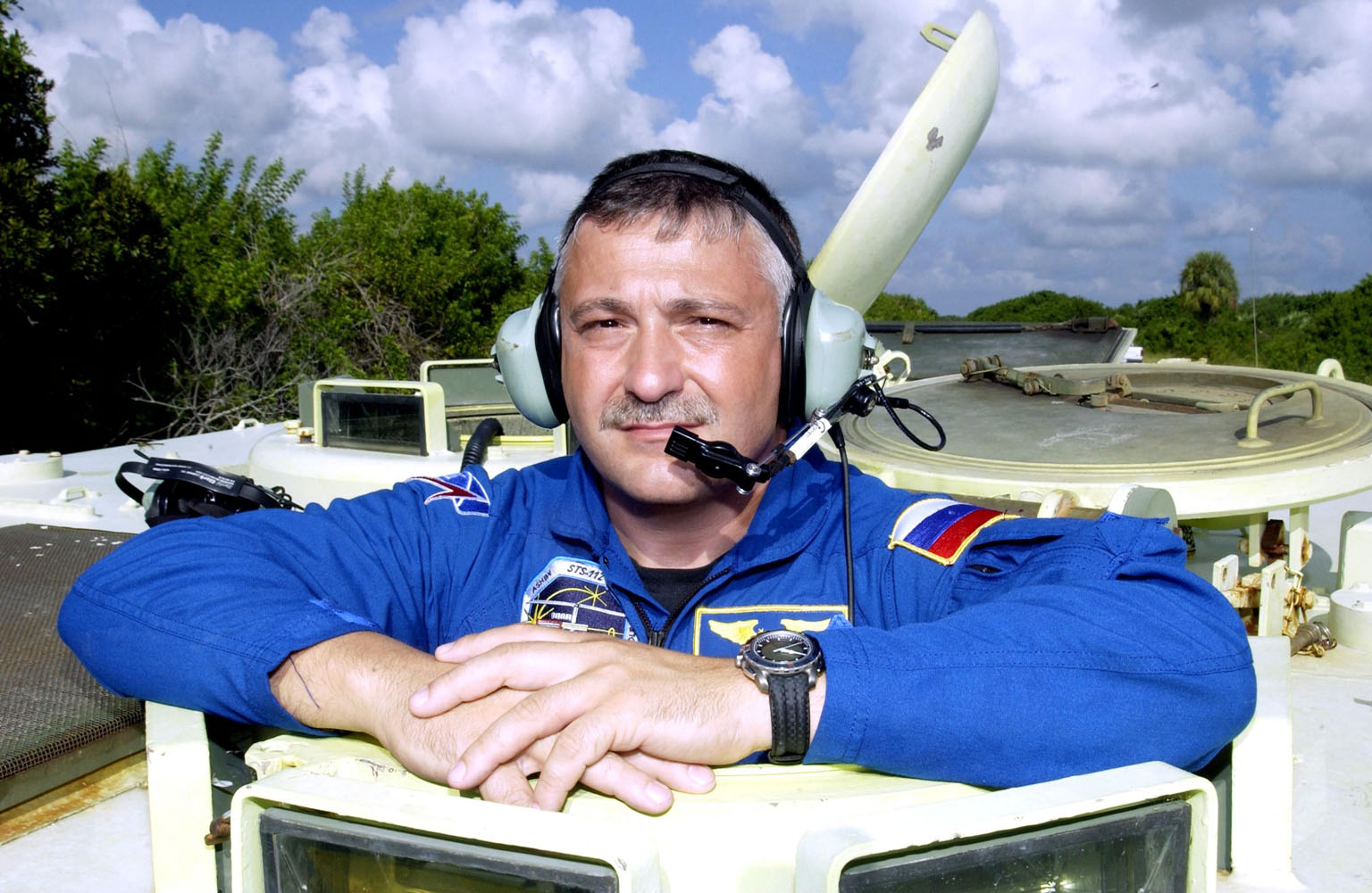 KENNEDY SPACE CENTER, Fla. - STS-112 Mission Specialist Fyodor Yurchikhin, with the Russian Space Agency, Ashby is ready for his practice run driving the M-113 armored personnel carrier. Yurchikhin and the rest of the crew are at KSC for Terminal Countdown Demonstration Test activities, which also include a simulated launch countdown. Mission STS-112 aboard Space Shuttle Atlantis is scheduled to launch no earlier than Oct. 2, between 2 and 6 p.m. EDT. STS-112 is the 15th assembly mission to the International Space Station. Atlantis will be carrying the S1 Integrated Truss Structure, the first starboard truss segment. The S1 will be attached to the central truss segment, S0, during the 11-day mission.