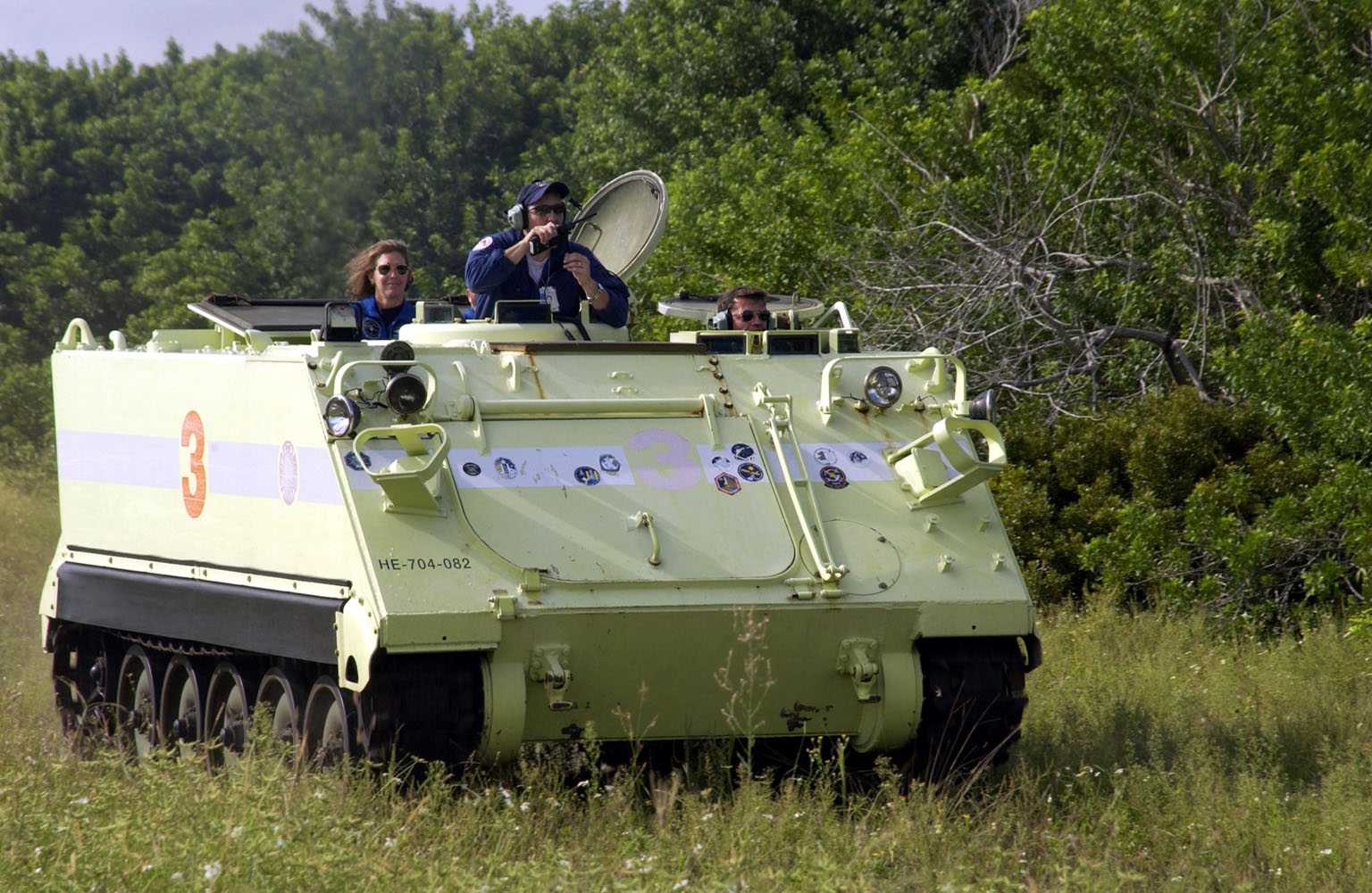 KENNEDY SPACE CENTER, Fla. - STS-112 Commander Jeffrey Ashby drives the M-113 armored personnel carrier during Terminal Countdown Demonstration Test activities. At the far left is Mission Specialist Sandra Magnus. The TCDT also includes a simulated launch countdown. The mission aboard Space Shuttle Atlantis is scheduled to launch no earlier than Oct. 2, between 2 and 6 p.m. EDT. STS-112 is the 15th assembly mission to the International Space Station. Atlantis will be carrying the S1 Integrated Truss Structure, the first starboard truss segment. The S1 will be attached to the central truss segment, S0, during the 11-day mission.