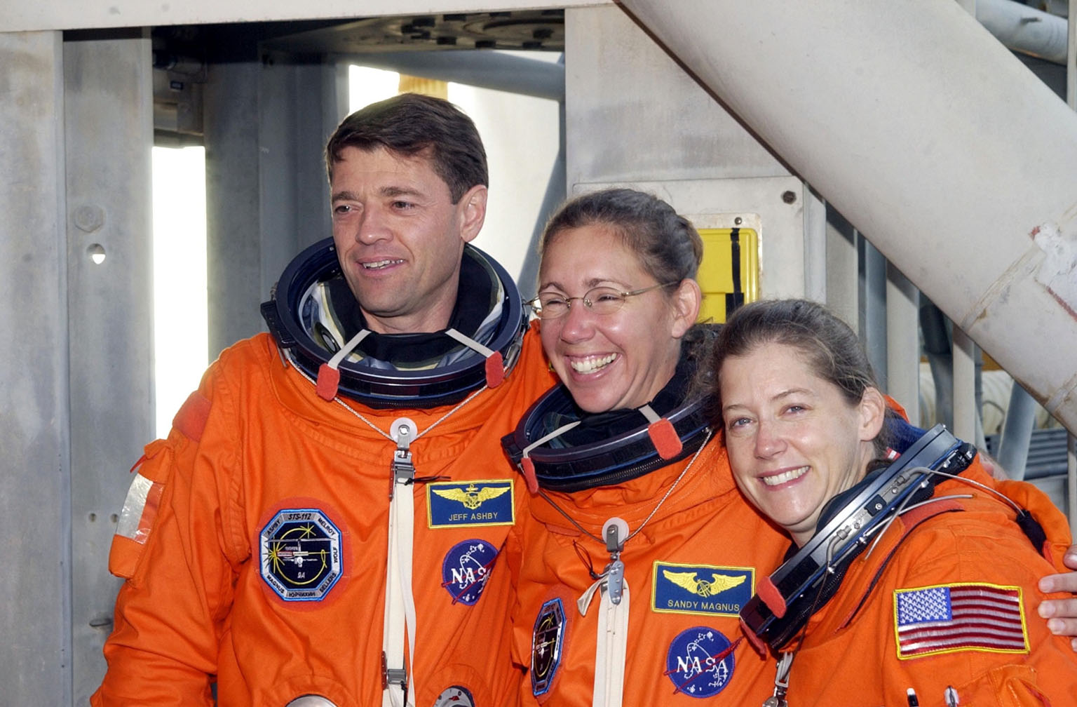KENNEDY SPACE CENTER, FLA. -- STS-112 Commander Jeffrey Ashby, Mission Specialist Sandra Magnus, and Pilot Pamela Melroy take a momentary break from training at Pad 39B during Terminal Countdown Demonstration Test activities, which include a simulated launch countdown. Launch of STS-112 aboard Space Shuttle Atlantis is scheduled for Oct. 2, between 2 and 6 p.m. EDT. STS-112 is the 15th assembly mission to the International Space Station. Atlantis will be carrying the S1 Integrated Truss Structure, the first starboard truss segment, to be attached to the central truss segment, S0, and the Crew and Equipment Translation Aid (CETA) Cart A. The CETA is the first of two human-powered carts that will ride along the ISS railway, providing mobile work platforms for future spacewalking astronauts.