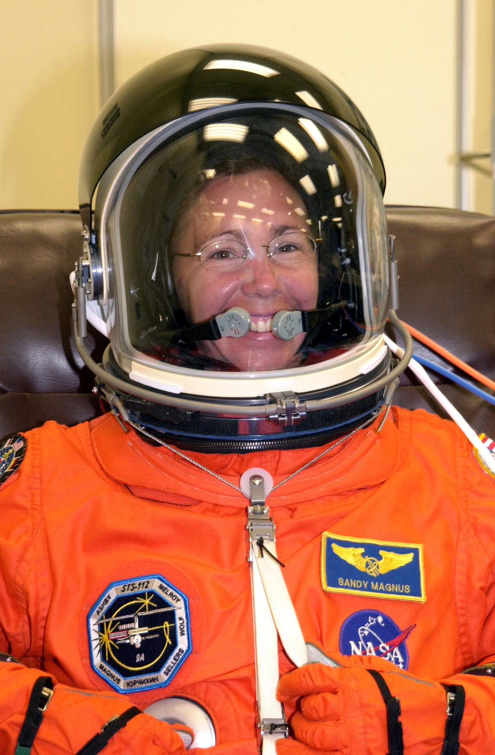 KENNEDY SPACE CENTER, FLA. --STS-112 Mission Specialist Sandra Magnus dons her spacesuit for a final fit check in preparation for her launch to the International Space Station aboard Atlantis. Launch is scheduled for Oct. 2 between 2 and 6 p.m. EDT.