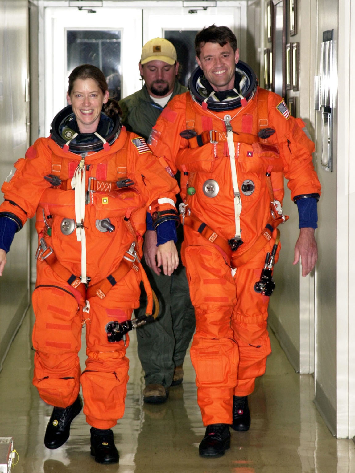 KENNEDY SPACE CENTER, FLA. --STS-112 Pilot Pamela Melroy (left) and Commander Jeffrey Ashby are suited up and ready to participate in landing exercises in the Shuttle Training Aircraft at the Shuttle Landing Facility.