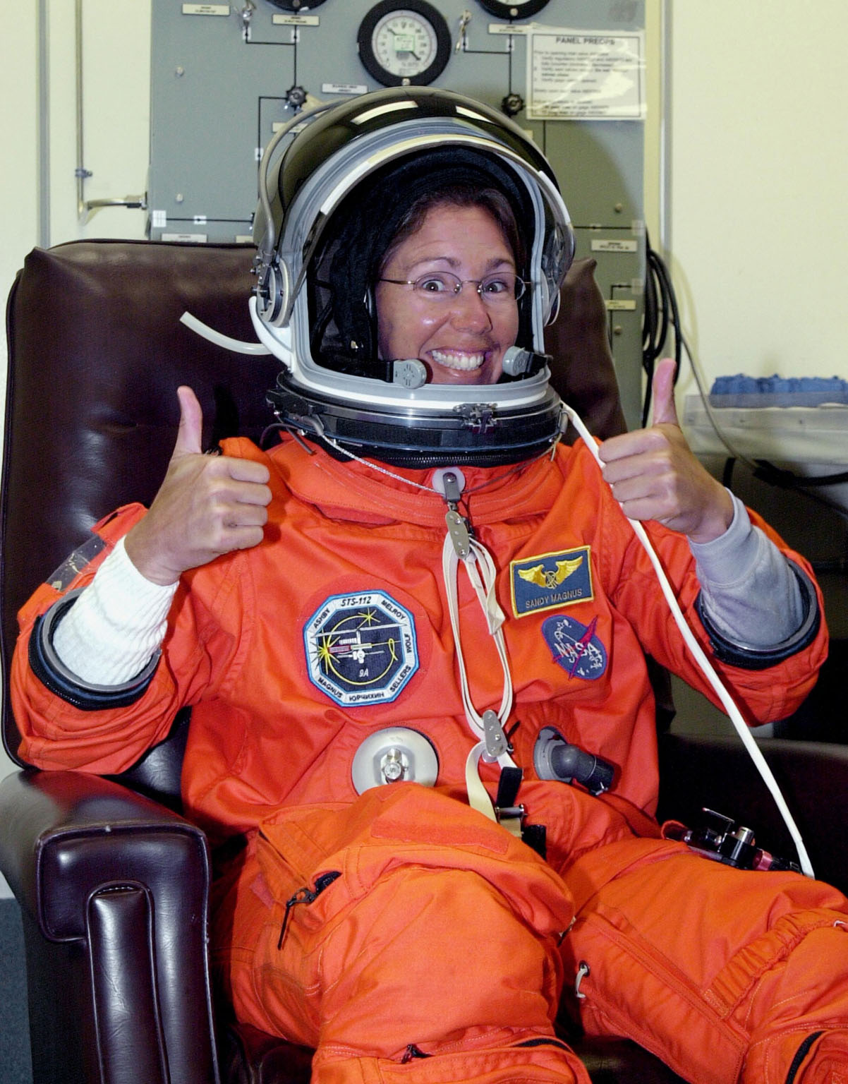 KENNEDY SPACE CENTER, FLA. - STS-112 Mission Specialist Sandra Magnus finishes suiting up before launch. STS-112 is the 15th assembly flight to the International Space Station, carrying the S1 Integrated Truss Structure and the Crew and Equipment Translation Aid (CETA) Cart A. The CETA is the first of two human-powered carts that will ride along the ISS railway, providing mobile work platforms for future spacewalking astronauts. On the 11-day mission, three spacewalks are planned to attach the S1 truss to the Station. Launch is scheduled for 3:46 p.m. EDT from Launch Pad 39B.