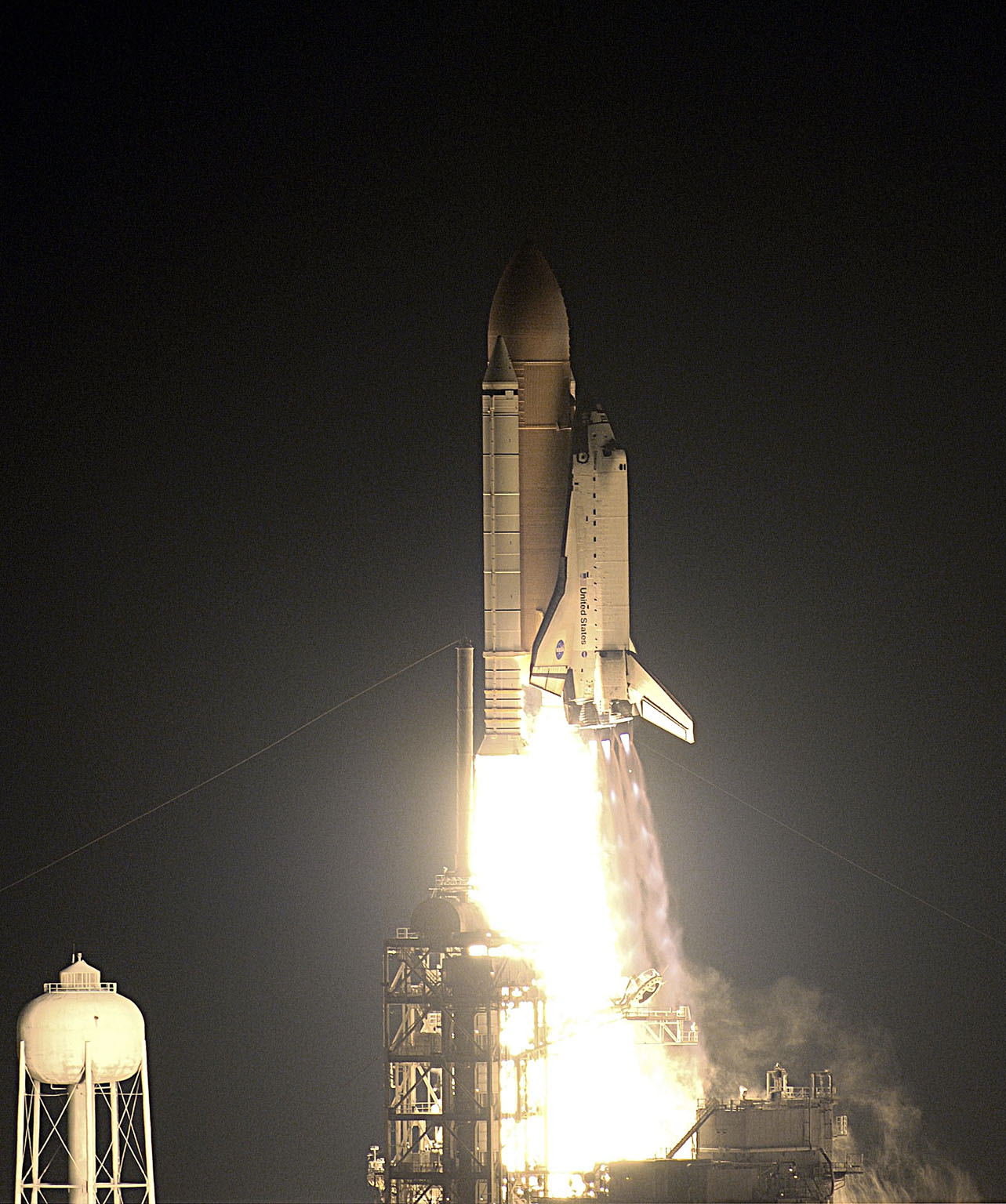 KENNEDY SPACE CENTER, FLA. - Against a black moonless sky, Space Shuttle Endeavour lights up the night as it blazes into space after an ontime liftoff at 7:49:47 p.m. EST. The launch is the 19th for Endeavour, and the 112th flight in the Shuttle program. Mission STS-113 is the 16th assembly flight to the International Space Station, carrying another structure for the Station, the P1 integrated truss. Also onboard are the Expedition 6 crew, who will replace Expedition 5. Endeavour is scheduled to land at KSC after an 11-day journey. [Photo by Scott Andrews]