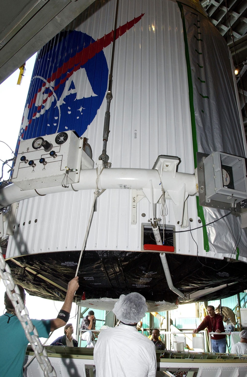 KENNEDY SPACE CENTER, FLA. -- The encapsulated TDRS-J satellite is lowered toward the Atlas IIA launch vehicle on Launch Complex 36-A, Cape Canaveral Air Force Station. The satellite is scheduled to be launched Dec. 4 aboard an Atlas IIA vehicle. The launch window is 9:42 to 10:22 p.m. EST. TDRS-J, the third in a series of telemetry satellites, will help replenish the current constellation of geosynchronous TDRS satellites that are the primary source of space-to-ground voice, data and telemetry for the Space Shuttle. The satellites also provide communications with the International Space Station and scientific spacecraft in low-Earth orbit such as the Hubble Space Telescope. This new advanced series of satellites will extend the availability of TDRS communications services until about 2017..