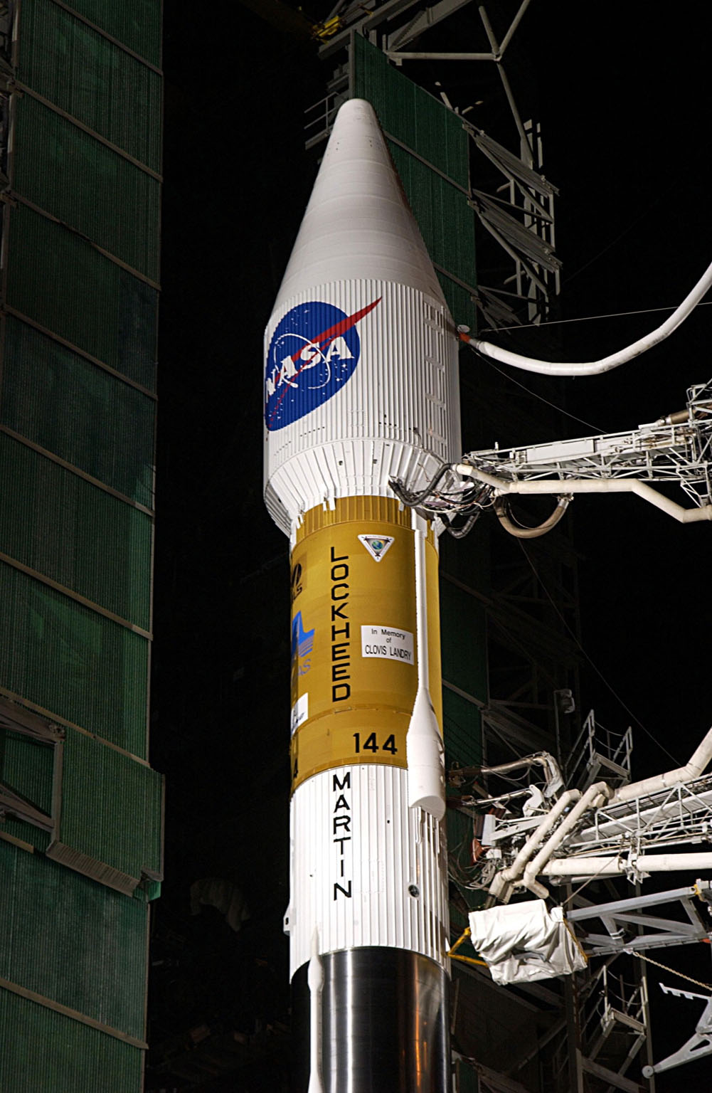 KENNEDY SPACE CENTER, FLA. - At Launch Complex 36-A, Cape Canaveral Air Force Station, the mobile service tower is rolled back to reveal the encapsulated TDRS-J satellite aboard an Atlas IIA vehicle awaiting launch on Dec. 4. The launch window is 9:42 to 10:22 p.m. EST. TDRS-J, the third in a series of telemetry satellites, will help replenish the current constellation of geosynchronous TDRS satellites that are the primary source of space-to-ground voice, data and telemetry for the Space Shuttle. The satellites also provide communications with the International Space Station and scientific spacecraft in low-Earth orbit such as the Hubble Space Telescope. This new advanced series of satellites will extend the availability of TDRS communications services until about 2017.