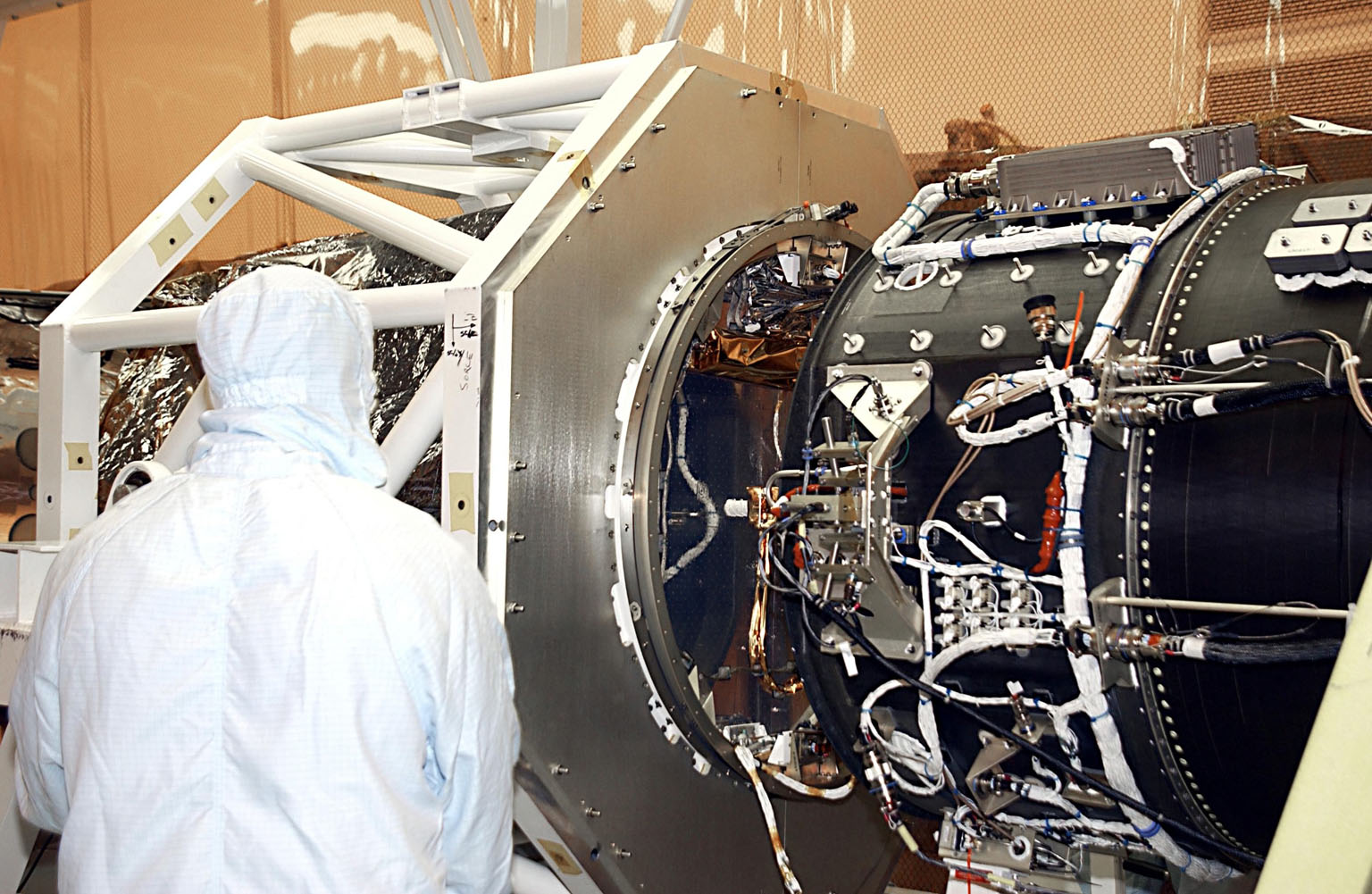 KENNEDY SPACE CENTER, FLA. -- In the Multi-Purpose Processing Facility, NASA's Solar Radiation and Climate Experiment (SORCE) closes in on the Pegasus XL Expendable Launch Vehicle for mating. SORCE will study and measure solar irradiance as a source of energy in the Earth's atmosphere. The launch of SORCE is scheduled for Jan. 25 at 3:14 p.m. from Cape Canaveral Air Force Station, Fla.