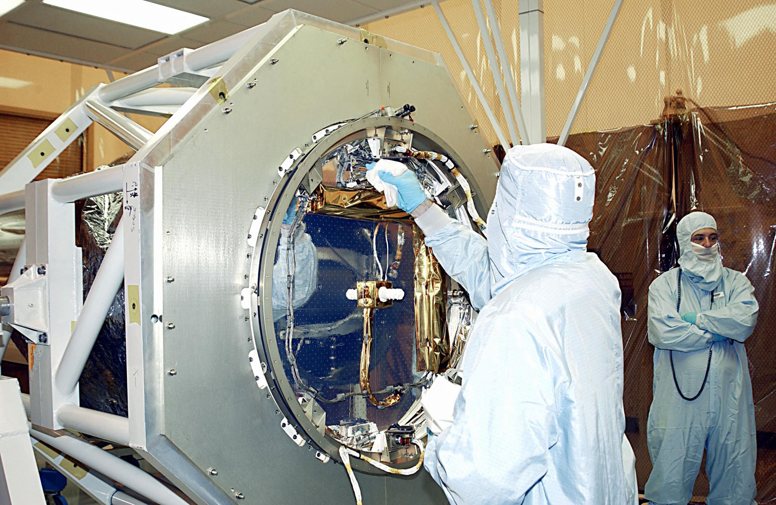 KENNEDY SPACE CENTER, FLA. -- In the Multi-Purpose Processing Facility, a technician cleans NASA's Solar Radiation and Climate Experiment (SORCE) before its mating to the Pegasus XL Expendable Launch Vehicle. Built by Orbital Sciences Space Systems Group, SORCE will study and measure solar irradiance as a source of energy in the Earth's atmosphere. The launch of SORCE is scheduled for Jan. 25 at 3:14 p.m. from Cape Canaveral Air Force Station, Fla.