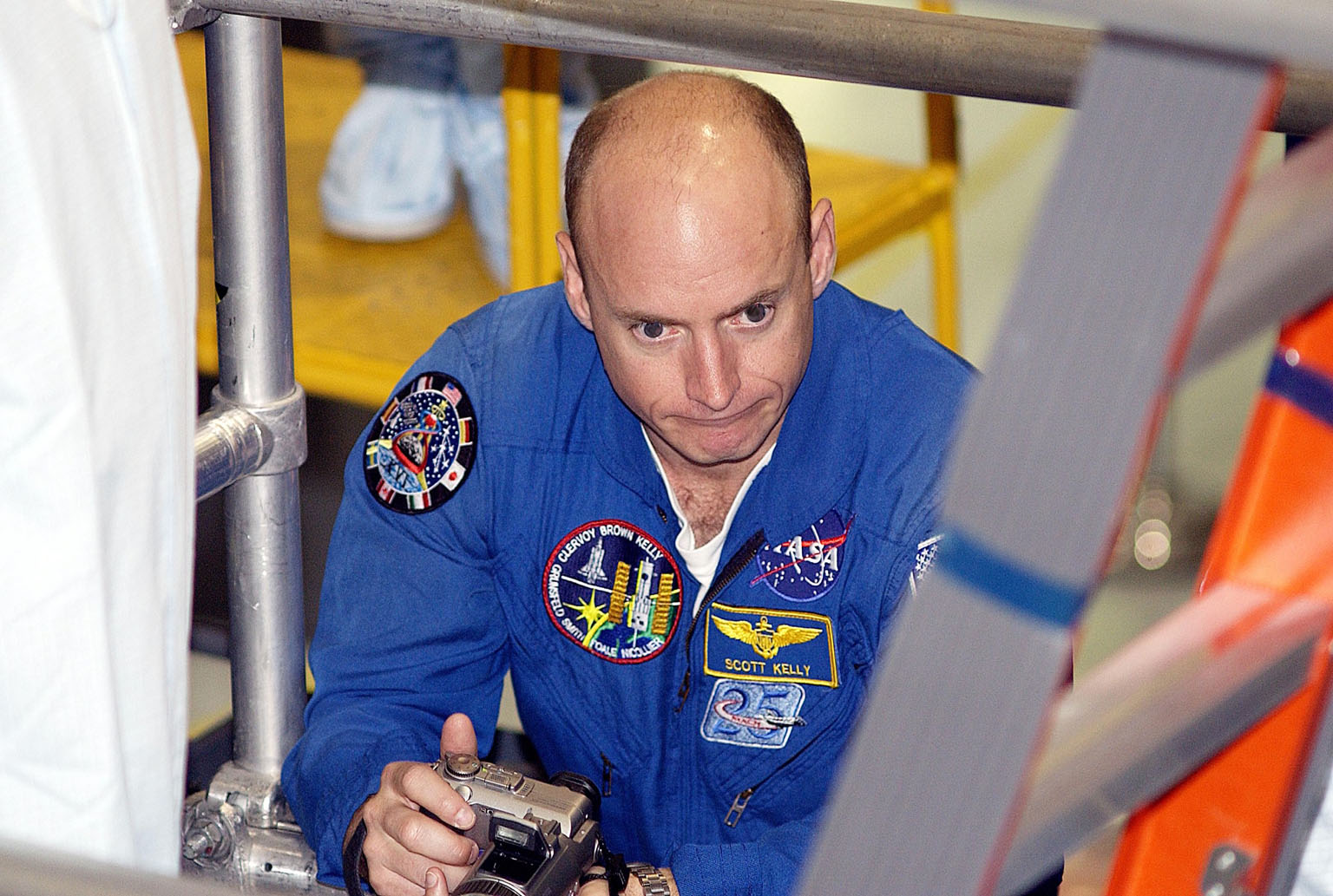 KENNEDY SPACE CENTER, FLA. - STS-118 Commander Scott Kelly holds a camera during training in the Space Station Processing Facility. He and other crew members are at KSC to become familiar with equipment for their mission. The mission will be delivering the third starboard truss segment, the ITS S5, to the International Space Station, and a SPACEHAB Single Cargo Module with supplies and equipment. Launch date is under review.