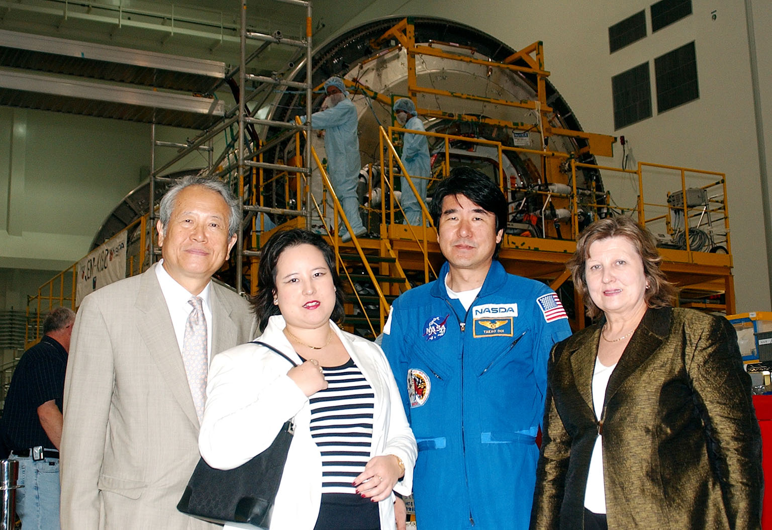 KENNEDY SPACE CENTER, FLA. - From left, the Consul General of Japan Ko Kodaira, his daughter Reiko, astronaut Dr. Takao Doi, and Kodaira's wife Marie pause for a photograph in the Space Station Processing Facility during their visit to Kennedy Space Center (KSC). Doi represented Japan on Space Shuttle mission STS-87, the fourth U.S Microgravity Payload flight. Kodaira is touring the facilities at KSC at the invitation of the local office of the National Space Development Agency of Japan (NASDA) to acquaint him with KSC's unique processing capabilities.