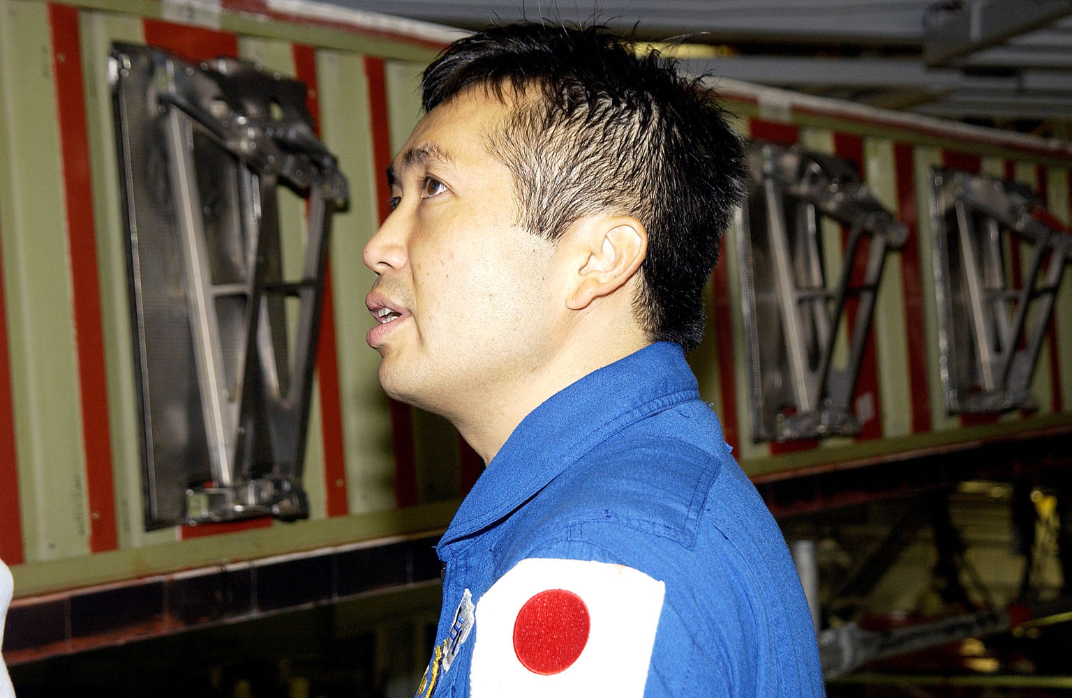 KENNEDY SPACE CENTER, FLA. - Japanese astronaut Koichi Wakata looks at the spars installed on the wing of the orbiter Atlantis. Reinforced Carbon Carbon (RCC) panels are mechanically attached to the wing via the spars - a series of floating joints - to reduce loading on the panels caused by wing deflections. The aluminum and the metallic attachments are protected from exceeding temperature limits by internal insulation.