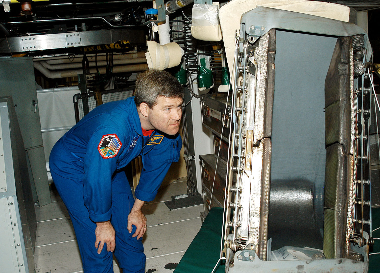 KENNEDY SPACE CENTER, FLA. - Astronaut Stephen Frick takes a close look at a reinforced carbon-carbon panel to be installed on orbiter Atlantis. Frick is a tile specialist, who joined the STS-114 crew during crew equipment and orbiter familiarization in the Orbiter Processing Facility.