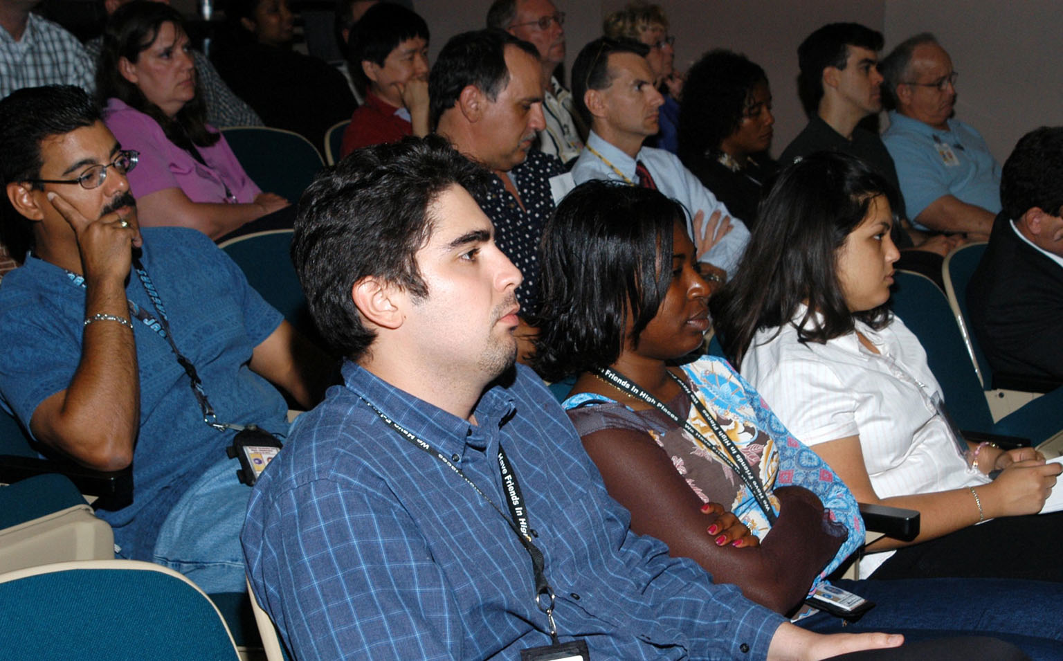 KENNEDY SPACE CENTER, FLA. -- KSC employees assemble in the Training Auditorium for a Culture Change Process All Hands Meeting. The purpose of the meeting was for employees to gain further insight into the Agency?s Vision for Space Exploration and the direction cultural change will take at KSC in order to assume its role within this vision. Panel members included James W. Kennedy, KSC director; Jim Jennings, Deputy Associate Administrator for Institutions and Asset Management; Lynn Cline, Deputy Associate Administrator for Space Flight; Bob Sieck, former Director of Space Shuttle Processing at KSC; and Jim Wetherbee, astronaut and Technical Assistant to the Director of Safety and Mission Assurance at the Johnson Space Center. Following their remarks, members of the panel entertained questions and comments from the audience.
