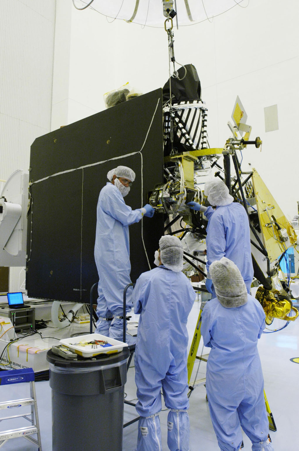 KENNEDY SPACE CENTER, FLA. - In the Payload Hazardous Servicing Facility at NASA?s Kennedy Space Center, engineers finish installing the gimbal on the Mars Reconnaissance Orbiter (MRO) solar panel. A gimbal is an appliance that allows an object to remain horizontal even as its support tips. In the PHSF, the spacecraft will undergo multiple mechanical assembly operations and electrical tests to verify its readiness for launch. A major deployment test will check out the spacecraft?s large solar arrays. The MRO was built by Lockheed Martin for NASA?s Jet Propulsion Laboratory in California. It is the next major step in Mars exploration and scheduled for launch from Cape Canaveral Air Force Station in a window opening Aug. 10. The MRO is an important next step in fulfilling NASA?s vision of space exploration and ultimately sending human explorers to Mars and beyond.