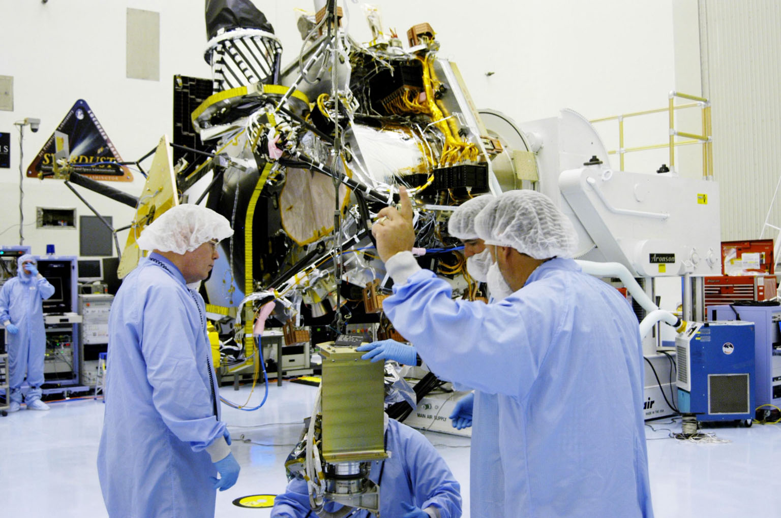 KENNEDY SPACE CENTER, FLA. - In the Payload Hazardous Servicing Facility at NASA?s Kennedy Space Center, engineers prepare to install the gimbal on the Mars Reconnaissance Orbiter (MRO) solar panel. A gimbal is an appliance that allows an object to remain horizontal even as its support tips. In the background is the orbiter. In the PHSF, the spacecraft will undergo multiple mechanical assembly operations and electrical tests to verify its readiness for launch. A major deployment test will check out the spacecraft?s large solar arrays. The MRO was built by Lockheed Martin for NASA?s Jet Propulsion Laboratory in California. It is the next major step in Mars exploration and scheduled for launch from Cape Canaveral Air Force Station in a window opening Aug. 10. The MRO is an important next step in fulfilling NASA?s vision of space exploration and ultimately sending human explorers to Mars and beyond.