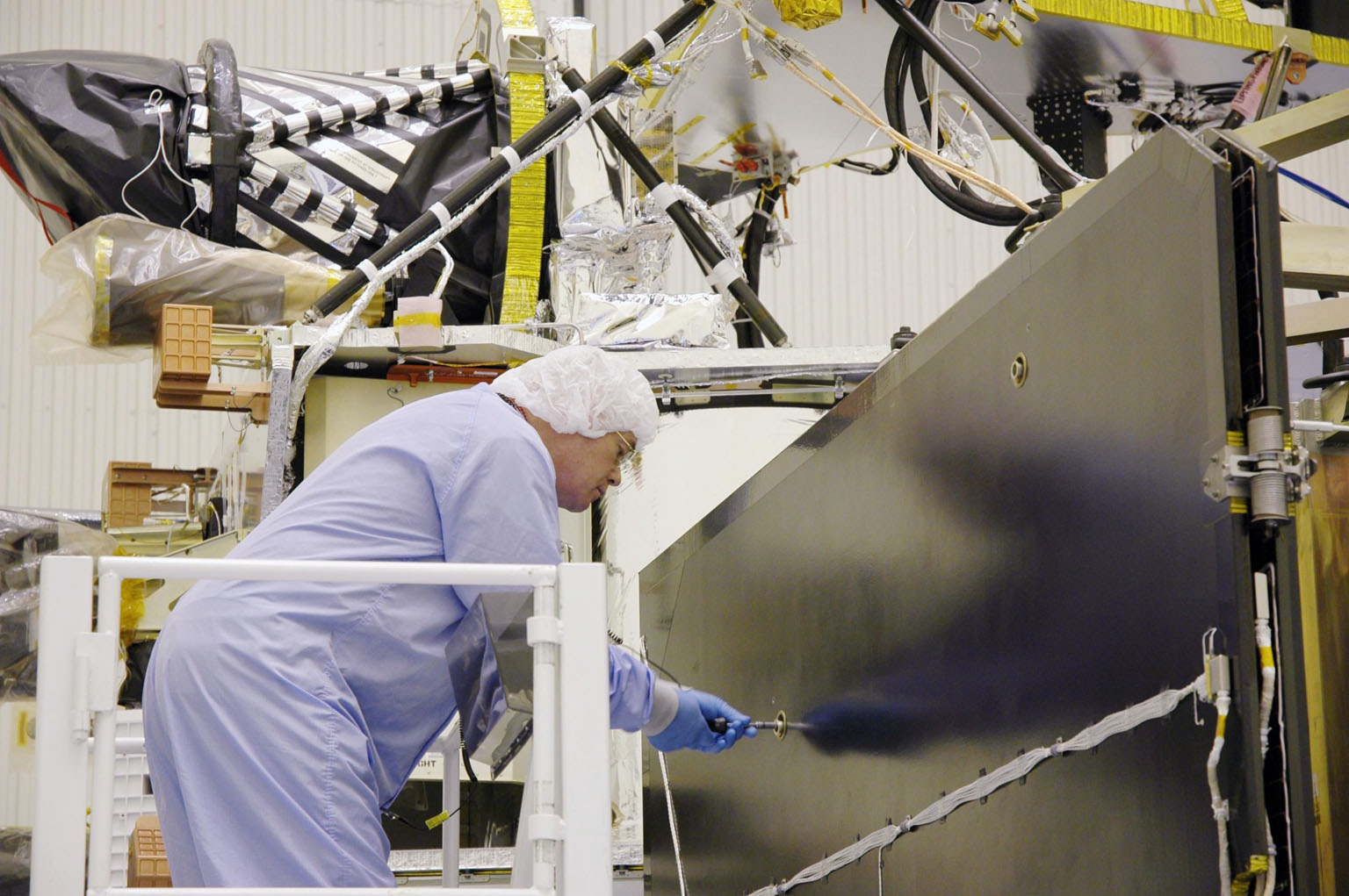 KENNEDY SPACE CENTER, FLA. - In the Payload Hazardous Servicing Facility, a technician prepares the solar arrays for the Mars Reconnaissance Orbiter (MRO) for an electromagnetic interference verification test. If no interference is found during the test, the Shallow Radar Antenna (SHARAD) will be installed on the spacecraft. The spacecraft is undergoing multiple mechanical assembly operations and electrical tests to verify its readiness for launch. The MRO was built by Lockheed Martin for NASA?s Jet Propulsion Laboratory in California. It is the next major step in Mars exploration and scheduled for launch from Launch Complex 41 at Cape Canaveral Air Force Station in a window opening Aug. 10. The MRO is an important next step in fulfilling NASA?s vision of space exploration and ultimately sending human explorers to Mars and beyond.