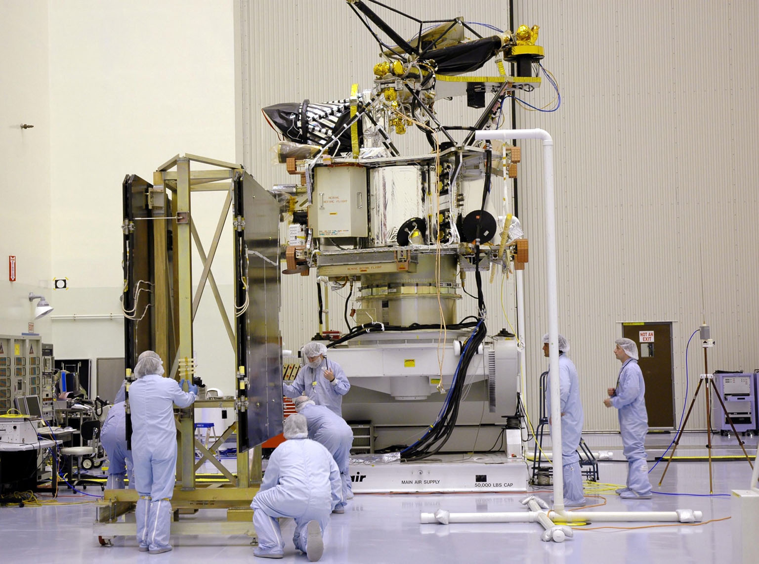 KENNEDY SPACE CENTER, FLA. - In the Payload Hazardous Servicing Facility, technicians position the solar arrays for the Mars Reconnaissance Orbiter (MRO) in preparation for an electromagnetic interference verification test. If no interference is found during the test, the Shallow Radar Antenna (SHARAD) will be installed on the spacecraft. The spacecraft is undergoing multiple mechanical assembly operations and electrical tests to verify its readiness for launch. The MRO was built by Lockheed Martin for NASA?s Jet Propulsion Laboratory in California. It is the next major step in Mars exploration and scheduled for launch from Launch Complex 41 at Cape Canaveral Air Force Station in a window opening Aug. 10. The MRO is an important next step in fulfilling NASA?s vision of space exploration and ultimately sending human explorers to Mars and beyond.