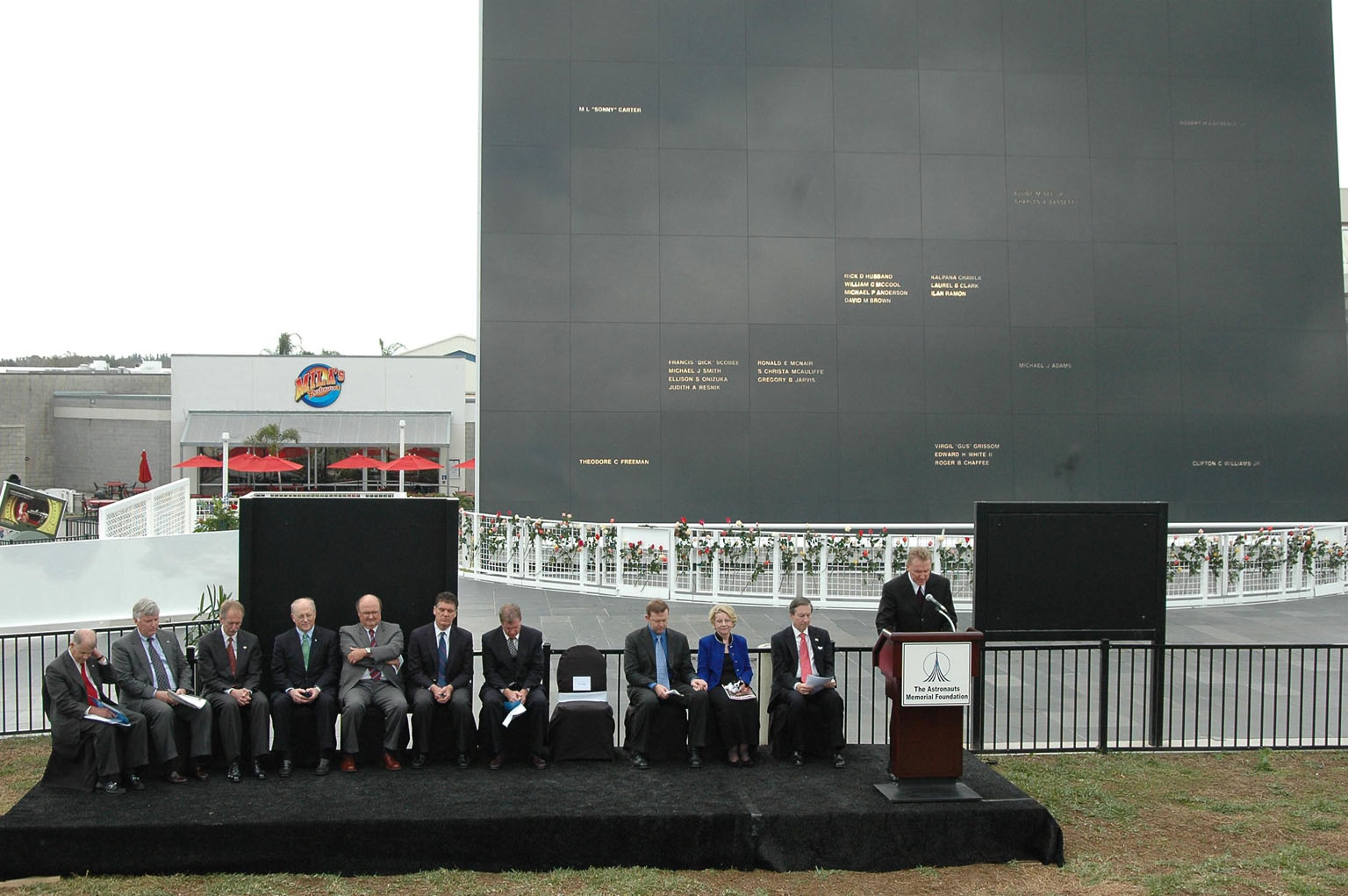 KENNEDY SPACE CENTER, FLA. ? Dr. Mick Ukleja gives the invocation at the opening of the Challenger memorial ceremony held Jan. 28 in front of the Space Memorial Mirror at NASA Kennedy Space Center?s Visitor Complex. Others participating in the ceremony are Dr. Stephen Feldman, president of the Astronauts Memorial Foundation; Rep. Dave Weldon and Rep. Tom Feeney; William Potter, chairman of the Board of Directors of the Astronauts Memorial Foundation; William Gerstenmaier, associate administrator for Space Operations at NASA; Jim Kennedy (second from left), center director of KSC; June Scobee Rodgers, widow of Dick Scobee, commander of Challenger; Col. Richard Scobee, son of Dick Scobee and June Scobee Rodgers; Capt. Frederick Hauck, commander of the first mission after Challenger; Dr. Joseph Allen, astronaut and scientist and chairman of the Board of the Challenger Centers for Space Science. June Scobee Rodgers and Gerstenmaier placed a wreath at the base of the memorial. Photo credit: NASA/Kim Shiflett