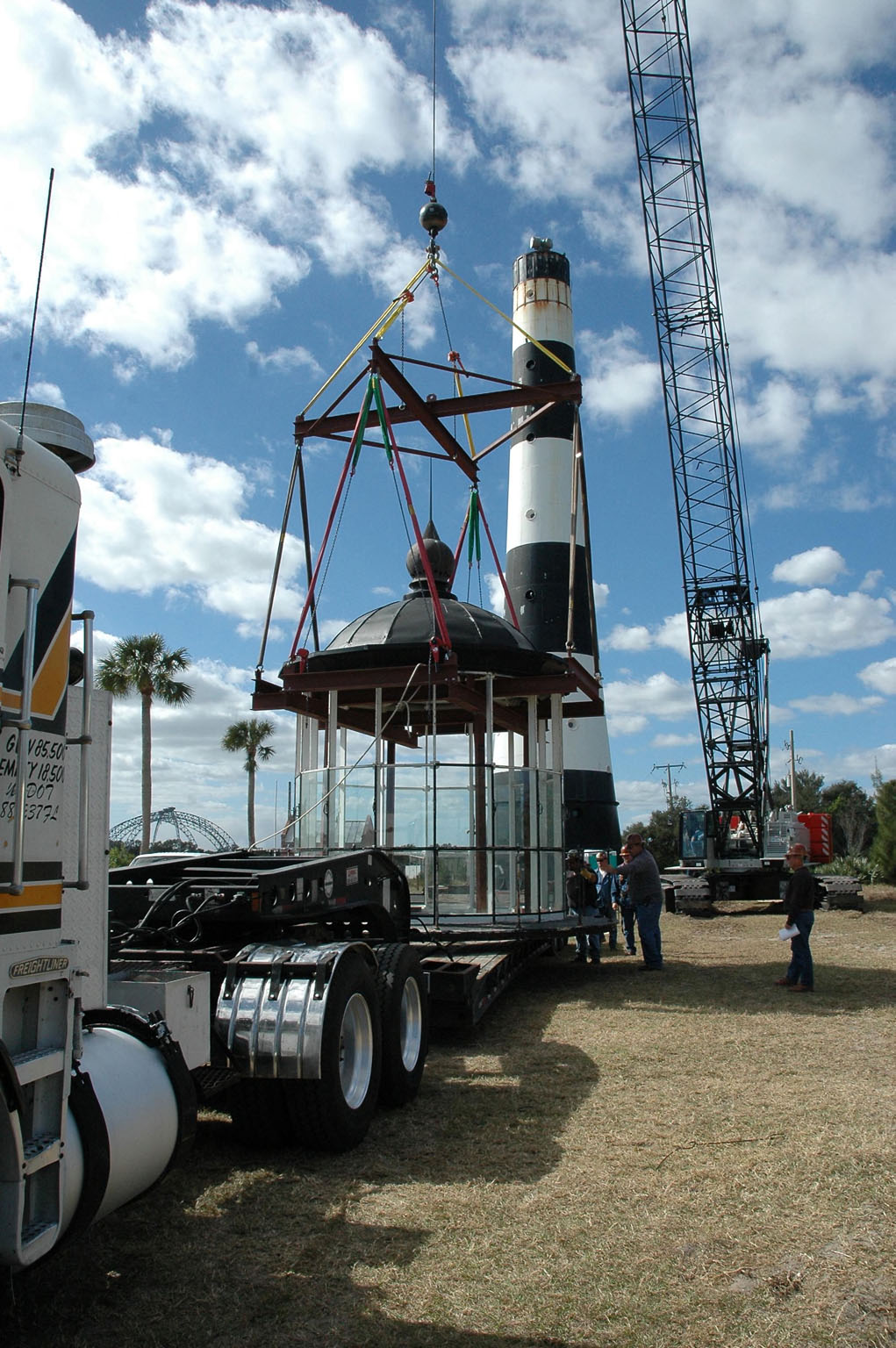 KENNEDY SPACE CENTER, FLA. - At Cape Canaveral Air Force Station, workers secure the lamp room detached from the Cape Canaveral Lighthouse onto a flat bed truck. Leaks in the roof allowed moisture to seep in. The lamp room will be moved to a facility near Cape Canaveral for repairs and renovation. The lamp room is being removed for repairs and refurbishment. In addition, the original brass roof will be restored and put back in place. The Cape Canaveral Lighthouse is the only operational lighthouse owned by the Air Force. It was first erected in 1868 near the edge of the Atlantic Ocean. Photo credit: NASA/Jack Pfaller