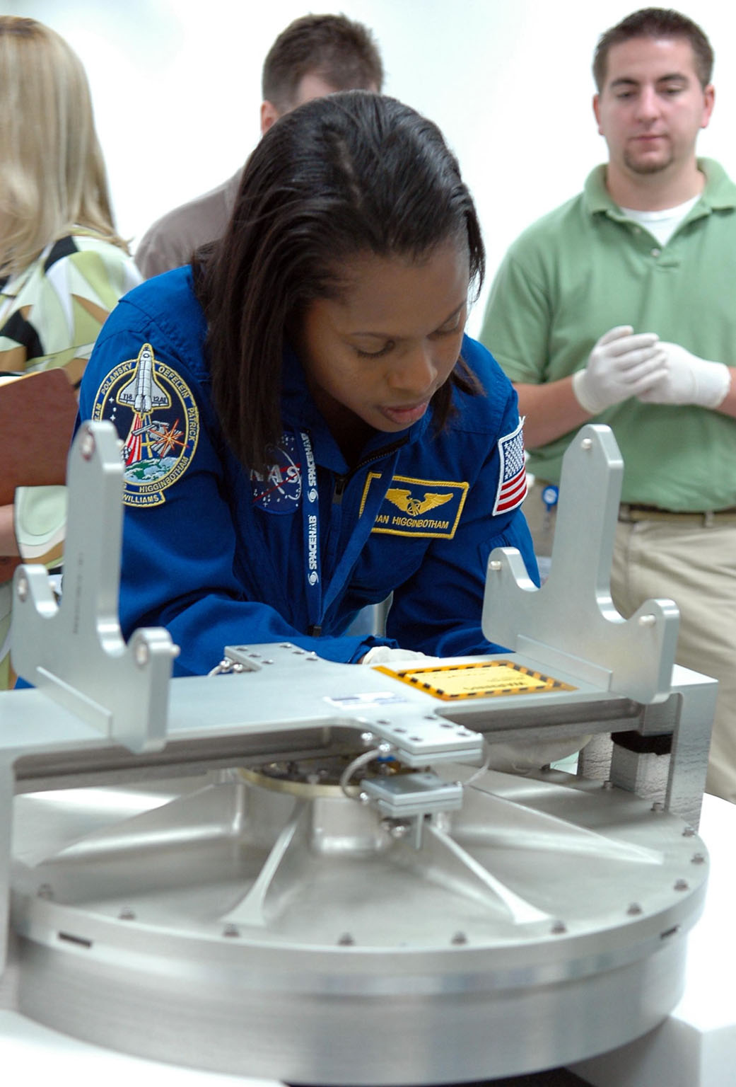 KENNEDY SPACE CENTER, FLA. - Inside the SPACEHAB Payload Processing Facility at Port Canaveral, Fla., STS-116 Mission Specialist Joan Higginbotham looks over flight hardware during the Crew Equipment Interface Test. Mission crews make frequent trips to the Space Coast to become familiar with the equipment and payloads they will be using. STS-116 will be mission No. 20 to the International Space Station and construction flight 12A.1. The mission payload is the SPACEHAB module, the P5 integrated truss structure and other key components. Launch is scheduled for no earlier than Dec. 7. Photo credit: NASA/Kim Shiflett