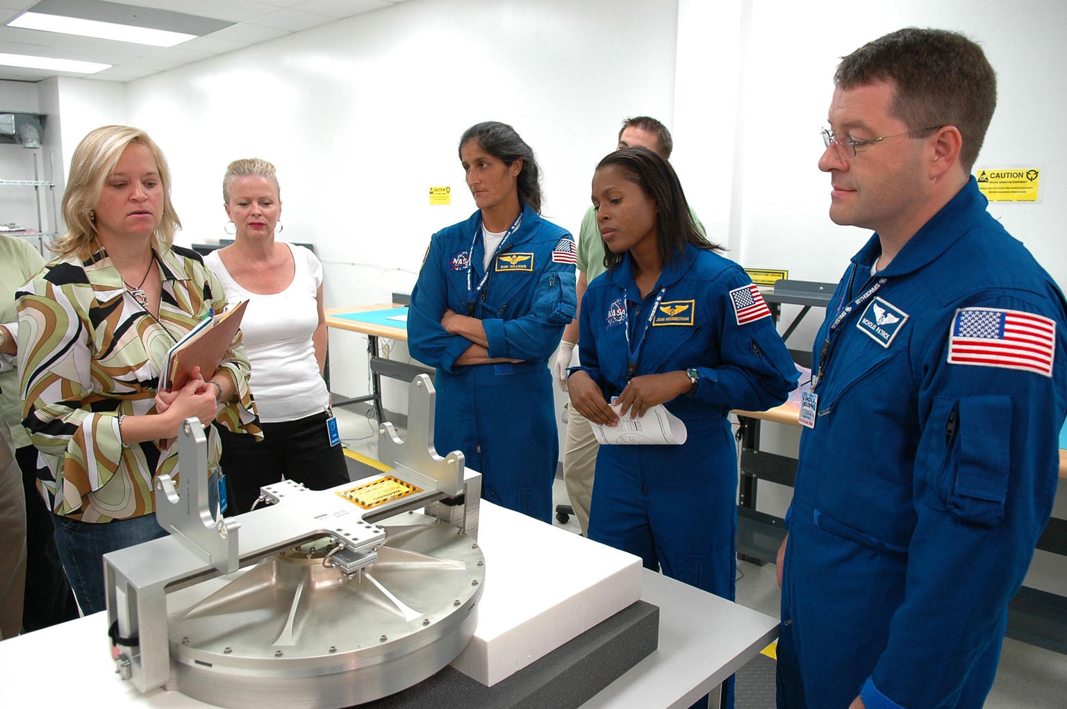 KENNEDY SPACE CENTER, FLA. - Inside the SPACEHAB Payload Processing Facility at Port Canaveral, Fla., STS-116 Mission Specialists (from left) Sunita Williams, Joan Higginbotham and Nicholas Patrick look over flight hardware during the Crew Equipment Interface Test. Mission crews make frequent trips to the Space Coast to become familiar with the equipment and payloads they will be using. STS-116 will be mission No. 20 to the International Space Station and construction flight 12A.1. The mission payload is the SPACEHAB module, the P5 integrated truss structure and other key components. Launch is scheduled for no earlier than Dec. 7. Photo credit: NASA/Kim Shiflett