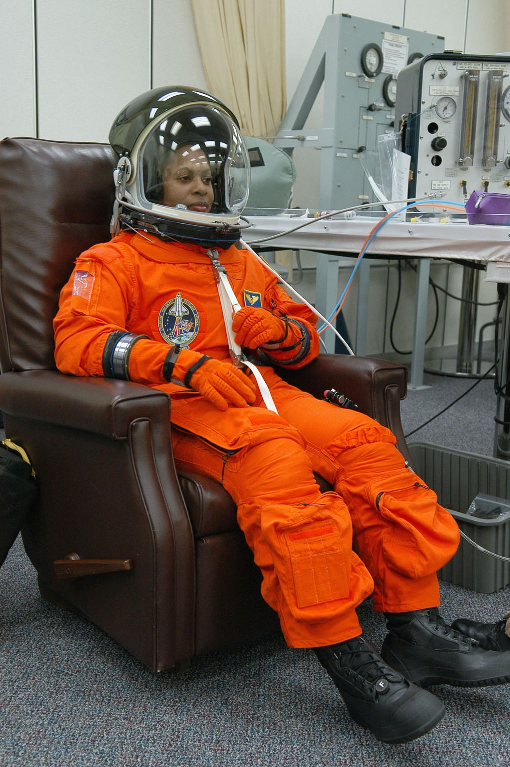 KENNEDY SPACE CENTER, FLA. -- The STS-116 mission crew practices for launch with a simulation of activities, from crew breakfast and suit-up to countdown in the orbiter. In this photo Mission Specialist Joan Higginbotham is suited up before heading to Launch Pad 39B. The STS-116 mission is No. 20 to the International Space Station and construction flight 12A.1. The mission payload is the SPACEHAB module, the P5 integrated truss structure and other key components. Launch is scheduled for no earlier than Dec. 7. Photo credit: NASA/Kim Shiflett