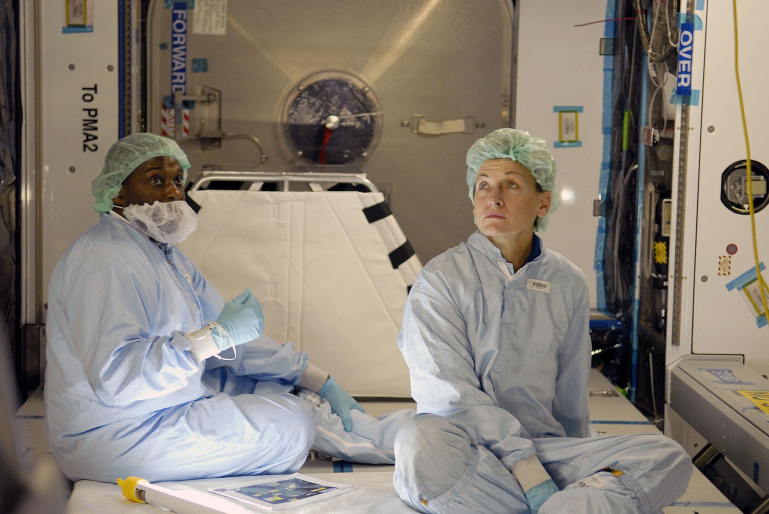 KENNEDY SPACE CENTER, FLA. -- In the Space Station Processing Facility at NASA's Kennedy Space Center, astronaut Peggy Whitson (right) is familiarizing herself with the U.S. Laboratory Node 2, which is the payload for mission STS-120 targeted for launch in September.