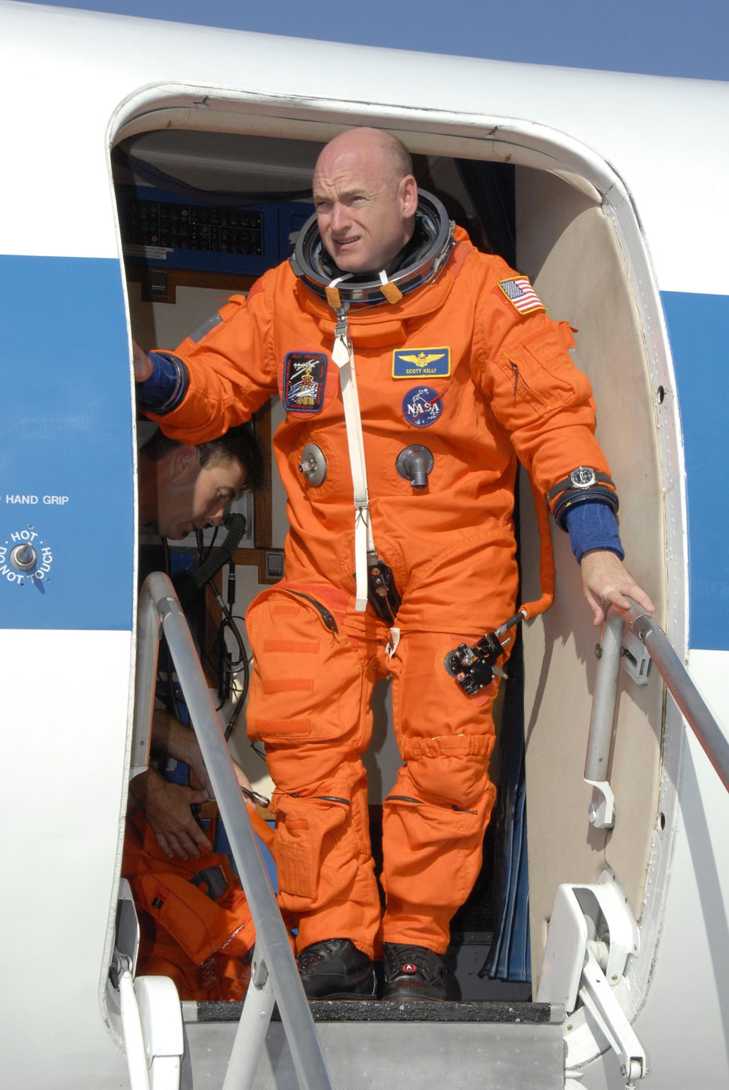 KENNEDY SPACE CENTER, FLA. - STS-118 Commander Scott Kelly disembarks from the shuttle training aircraft, or STA, at the Shuttle Landing Facility, Kennedy Space Center's airstrip. He and STS-118 Pilot Charlie Hobaugh were at the facility to practice landings for their upcoming mission. The STA is a Grumman American Aviation-built Gulf Stream II jet that was modified to simulate an orbiter's cockpit, motion and visual cues, and handling qualities. In flight, the STA duplicates the orbiter's atmospheric descent trajectory from approximately 35,000 feet altitude to landing on a runway. Endeavour's STS-118 mission is the 22nd shuttle flight to the International Space Station. It will continue space station construction by delivering a third starboard truss segment, S5. Other payloads include the SPACEHAB module, making its last voyage, and the external stowage platform 3 with a control moment gyroscope on it. The flight will include at least three spacewalks. The crew will also debut a new system that enables docked shuttles to draw electrical power from the station to extend visits to the outpost. Launch is set for Aug. 8 at 6:36 p.m. EDT. NASA/Kim Shiflett