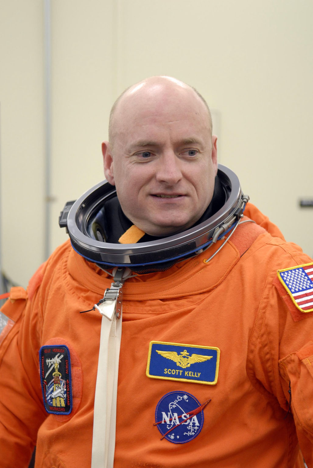 KENNEDY SPACE CENTER, FLA. -- In the Operations and Checkout Building, STS-118 Commander Scott Kelly dons his launch and entry suit for launch aboard Space Shuttle Endeavour. This is Kelly's second spaceflight. The STS-118 mission is the 22nd shuttle flight to the International Space Station. It will continue space station construction by delivering a third starboard truss segment, S5, and other payloads such as the SPACEHAB module and the external stowage platform 3. The 11-day mission may be extended to as many as 14 depending on the test of the Station-to-Shuttle Power Transfer System that will allow the docked shuttle to draw electrical power from the station and extend its visits to the orbiting lab. NASA/Kim Shiflett