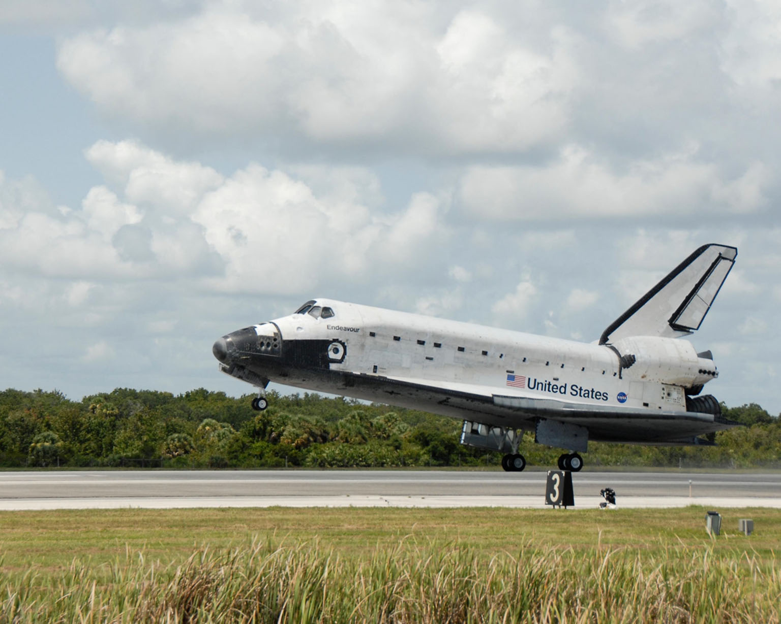 KENNEDY SPACE CENTER, FLA. -- Endeavour touches down on runway 15 at NASA's Kennedy Space Center. The Space Shuttle Endeavour crew, led by Commander Scott Kelly, completes a 13-day mission to the International Space Station. The STS-118 mission began Aug. 8 and installed a new gyroscope, an external spare parts platform and another truss segment to the expanding station. Endeavour's main gear touched down at 12:32:16 p.m. EDT. Nose gear touchdown was at 12:32:29 p.m. and wheel stop was at 12:33:20 p.m. Endeavour traveled nearly 5.3 million miles, landing on orbit 201. STS-118 was the 119th space shuttle flight, the 22nd flight to the station, the 20th flight for Endeavour and the second of four missions planned for 2007. This was the 65th landing of an orbiter at Kennedy. Photo credit: NASA/Kim Shiflett