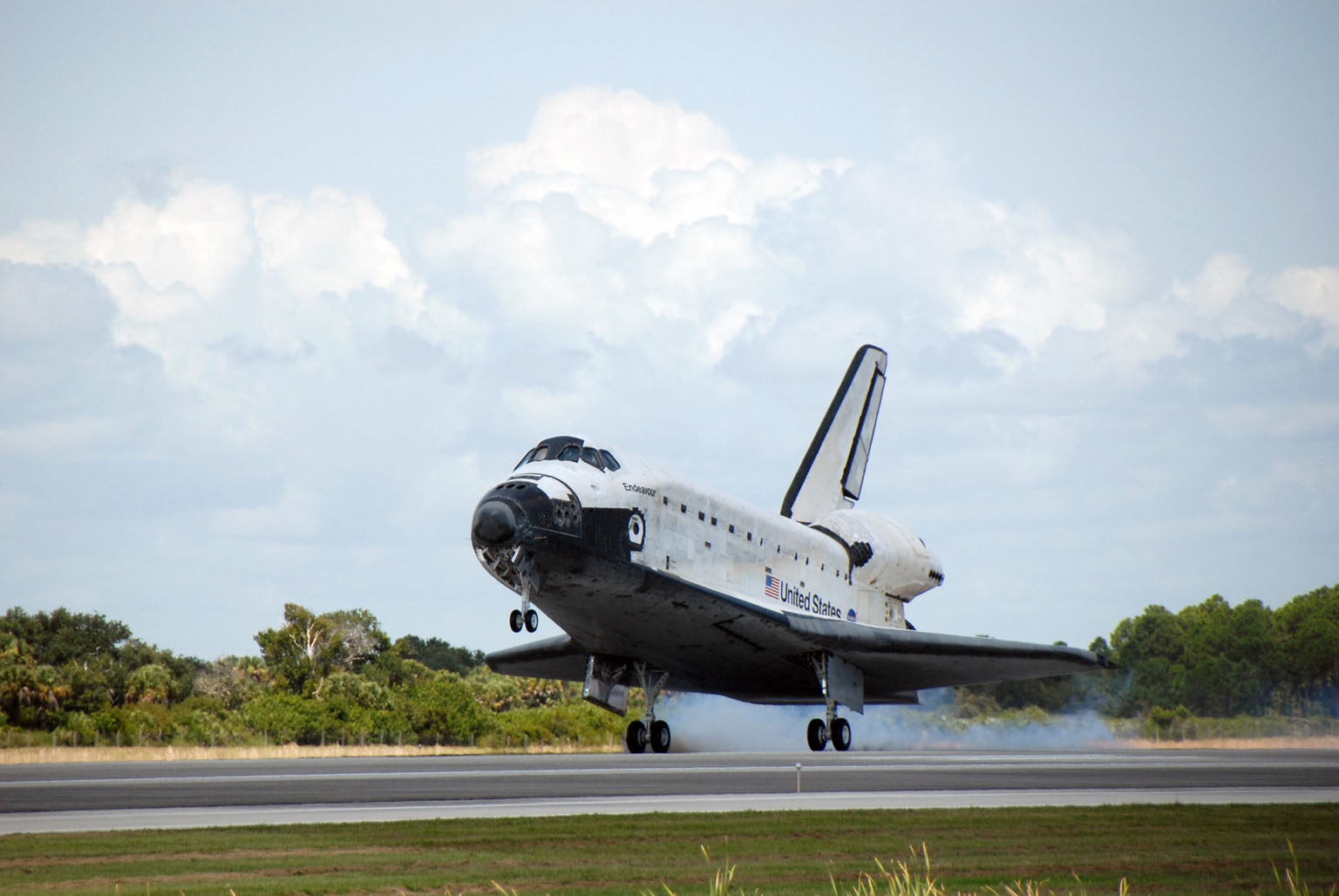 KENNEDY SPACE CENTER, FLA. -- Endeavour kicks up dust as it touches down on runway 15 at NASA's Kennedy Space Center. The Space Shuttle Endeavour crew, led by Commander Scott Kelly, completes a 13-day mission to the International Space Station. The STS-118 mission began Aug. 8 and installed a new gyroscope, an external spare parts platform and another truss segment to the expanding station. Endeavour's main gear touched down at 12:32:16 p.m. EDT. Nose gear touchdown was at 12:32:29 p.m. and wheel stop was at 12:33:20 p.m. Endeavour traveled nearly 5.3 million miles, landing on orbit 201. STS-118 was the 119th space shuttle flight, the 22nd flight to the station, the 20th flight for Endeavour and the second of four missions planned for 2007. This was the 65th landing of an orbiter at Kennedy. Photo credit: NASA/Kim Shiflett