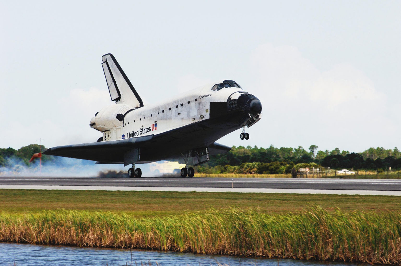 KENNEDY SPACE CENTER, FLA. -- Endeavour kicks up dust as it touches down on runway 15 at NASA's Kennedy Space Center after traveling nearly 5.3 million miles on mission STS-118. The Space Shuttle Endeavour crew, led by Commander Scott Kelly, completes a 13-day mission to the International Space Station. The STS-118 mission began Aug. 8 and installed a new gyroscope, an external spare parts platform and another truss segment to the expanding station. Endeavour's main gear touched down at 12:32:16 p.m. EDT. Nose gear touchdown was at 12:32:29 p.m. and wheel stop was at 12:33:20 p.m. Endeavour landed on orbit 201. STS-118 was the 119th space shuttle flight, the 22nd flight to the station, the 20th flight for Endeavour and the second of four missions planned for 2007. This was the 65th landing of an orbiter at Kennedy. Photo credit: NASA/Rafael Hernandez