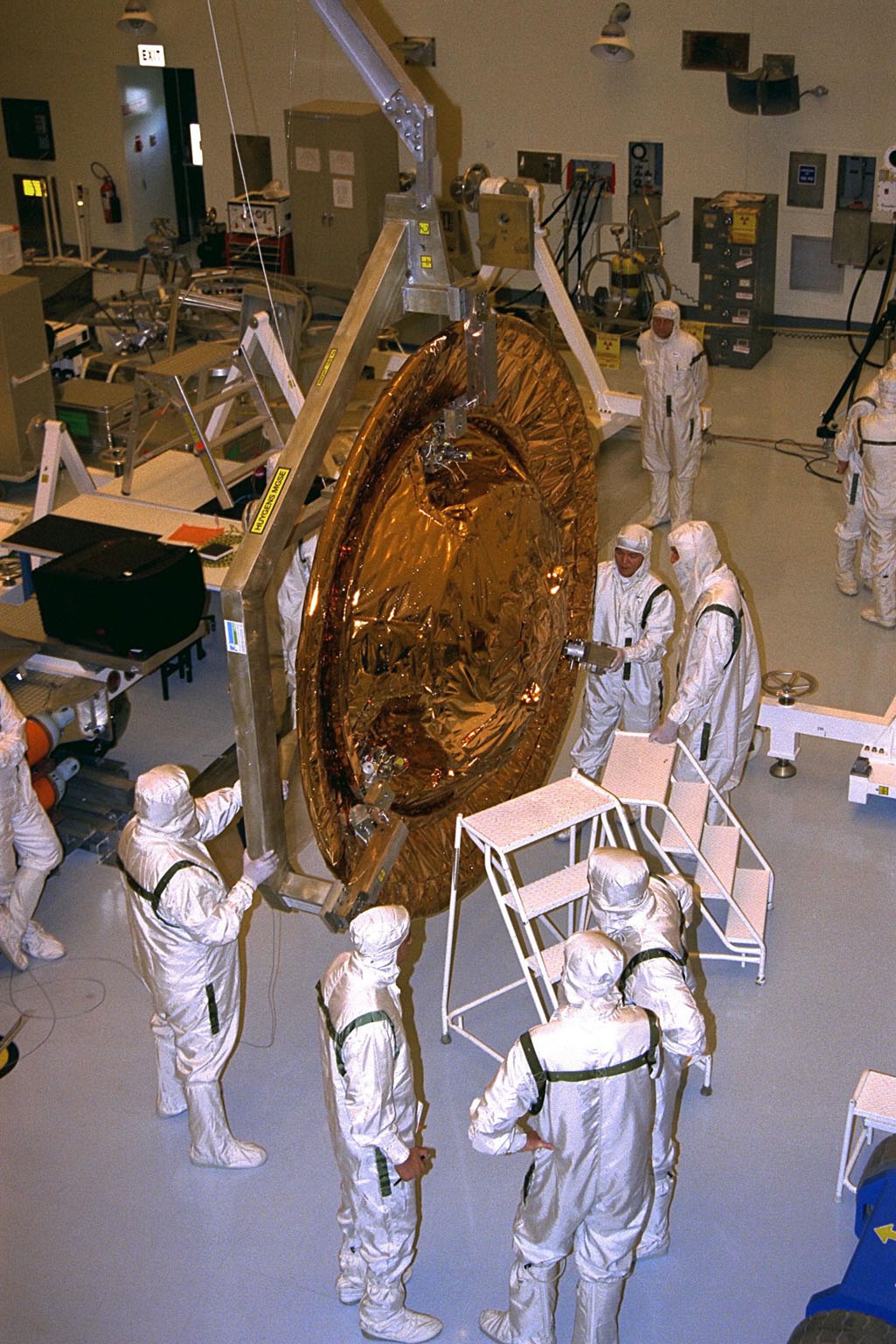The Huygens probe is installed into the Cassini orbiter in the Payload Hazardous Servicing Facility (PHSF)