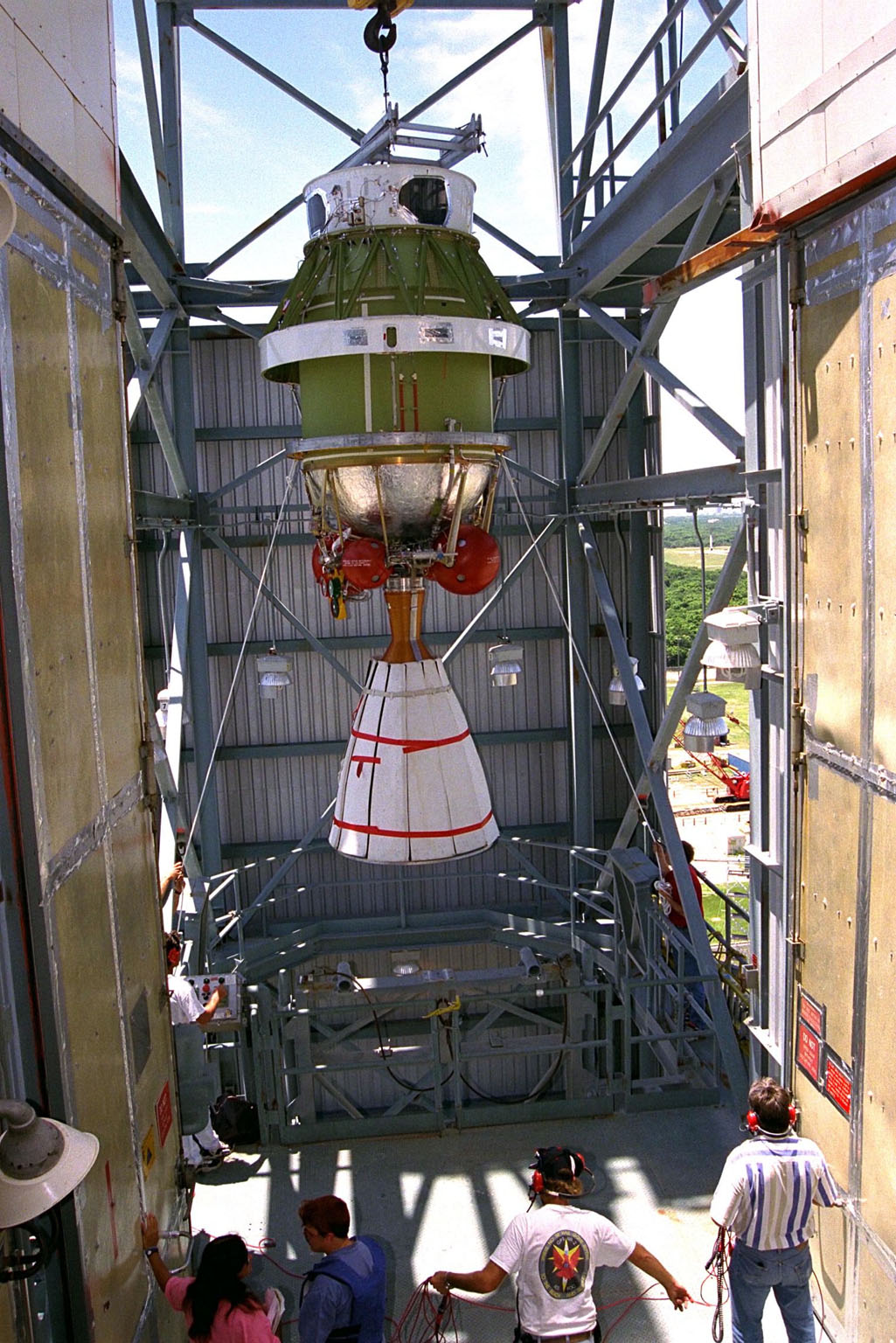 The second stage of the Delta II rocket which will to be used to launch the Advanced Composition Explorer (ACE) spacecraft is erected at Launch Complex 17A at Cape Canaveral Air Station. Scheduled for launch on Aug. 25, ACE will study low-energy particles of solar origin and high-energy galactic particles. The ACE observatory will be placed into an orbit almost a million miles (1.5 million kilometers) away from the Earth, about 1/100 the distance from the Earth to the Sun