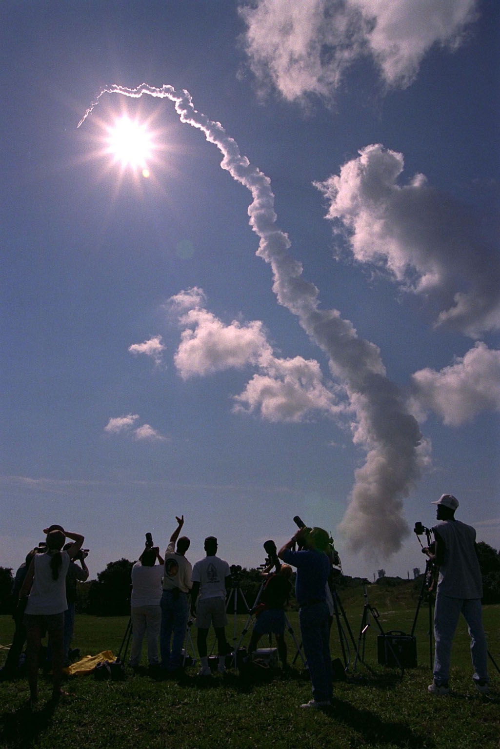 Photographers and other onlookers watch as a Boeing Delta II expendable launch vehicle lifts off with NASA?s Advanced Composition Explorer (ACE) observatory at 10:39 a.m. EDT, on Aug. 25, 1997, from Launch Complex 17A, Cape Canaveral Air Station. This is the second Delta launch under the Boeing name and the first from Cape Canaveral. Liftoff had been scheduled for Aug. 24, but was scrubbed one day by Air Force range safety personnel because two commercial fishing vessels were within the Delta?s launch danger area. The ACE spacecraft will study low-energy particles of solar origin and high-energy galactic particles on its one-million-mile journey. The collecting power of instruments aboard ACE is 10 to 1,000 times greater than anything previously flown to collect similar data by NASA. Study of these energetic particles may contribute to our understanding of the formation and evolution of the solar system. ACE has a two-year minimum mission lifetime and a goal of five years of service. ACE was built for NASA by the Johns Hopkins Applied Physics Laboratory and is managed by the Explorer Project Office at NASA's Goddard Space Flight Center. The lead scientific institution is the California Institute of Technology (Caltech) in Pasadena, Calif