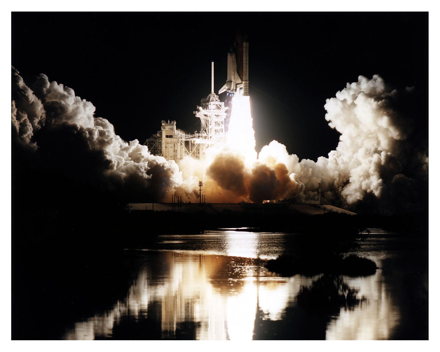 """Like a rising sun lighting up the night, the Space Shuttle Atlantis soars from Launch Pad 39B at 4:27:23 a.m. EST Jan. 12 on its way to dock with the Mir space station for the fifth time. The 10-day mission will feature the transfer of Mission Specialist Jerry Linenger to Mir to replace astronaut John Blaha, who has been on the orbital laboratory since Sept. 19, 1996. The other STS-81 crew members include Mission Commander Michael A. Baker; Pilot Brent W. Jett, Jr.; and Mission Specialists John M. Grunsfeld, Peter J. K. """"Jeff"""" Wisoff and Marsha S. Ivins. During the five-day docking operations, the Shuttle and Mir crews will conduct risk mitigation, human life science, microgravity and materials processing experiments that will provide data for the design, development and operation of the International Space Station. The primary payload is the SPACEHAB-DM double module that will provide space for more than 2,000 pounds of hardware, food and water that will be transferred into the Russian space station.The SPACEHAB will also be used to return experiment samples from the Mir to Earth for analysis and for microgravity experiments during the mission"""