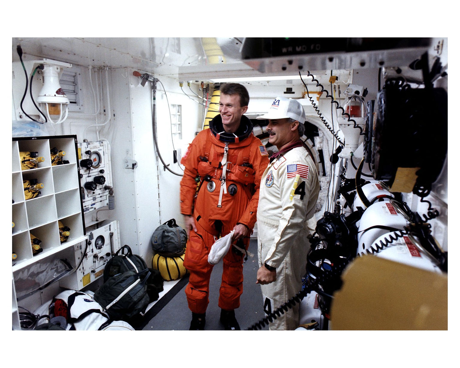 Pilot Jett talks to members of the suiting crew in the white room at Pad 39B before entering the Space Shuttle Atlantis for launch of the STS-81 mission