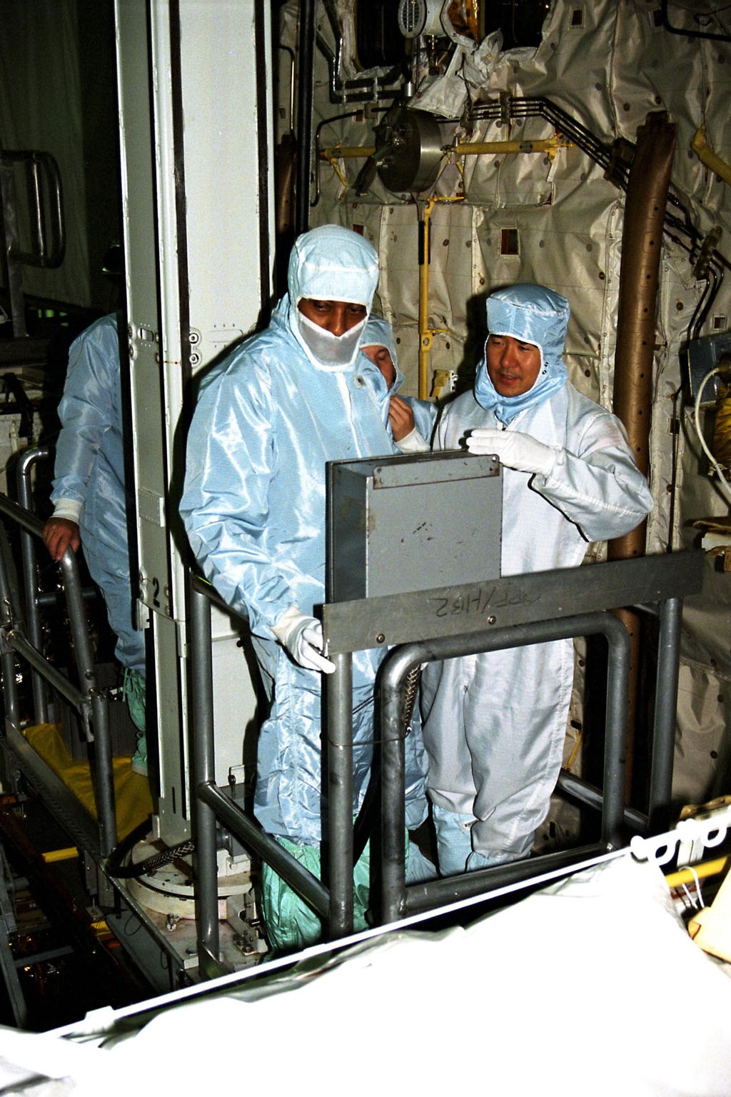 Participating in the Crew Equipment Integration Test (CEIT) at Kennedy Space Center are STS-87 crew members Winston Scott, at left, and Takao Doi, Ph.D., of the National Space Development Agency of Japan, both mission specialists on STS-87. The CEIT gives astronauts an opportunity to get a hands-on look at the payloads with which they will be working on-orbit. STS-87 will be the fourth United States Microgravity Payload and flight of the Spartan-201 deployable satellite. During the STS-87 mission, scheduled for a Nov. 19 liftoff from KSC, Dr. Doi and Scott will both perform spacewalks. STS-87 is scheduled for a Nov. 19 liftoff from KSC