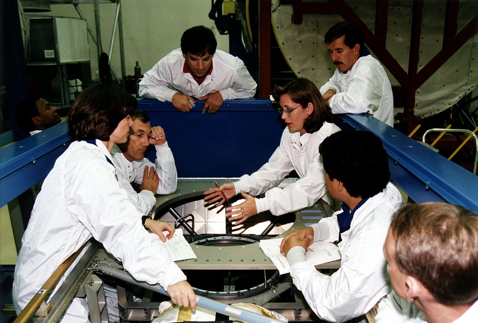 KENNEDY SPACE CENTER, FLA. -- STS-89 crew members participate with trainers in the Crew Equipment Interface Test (CEIT) at the SPACEHAB Payload Processing Facility at Port Canaveral in preparation for the mission, slated to be the first Shuttle launch of 1998. The CEIT gives astronauts an opportunity to get a hands-on look at the payloads with which they will be working on-orbit. From left to right are Mission Specialists Michael Anderson and Bonnie Dunbar, Ph.D.; Commander Terry Wilcutt; Boeing SPACEHAB Operations Engineer Jim Behling; Boeing SPACEHAB Crew Trainer Laura Keiser; an unidentified staff member (with mustache); Mission Specialist Salizhan Sharipov of the Russian Space Agency; and Pilot Joe Edwards. STS-89 will be the eighth of nine scheduled Mir dockings and will include a double module of SPACEHAB, used mainly as a large pressurized cargo container for science, logistical equipment and supplies to be exchanged between the orbiter Endeavour and the Russian Space Station Mir. The nineday flight of STS-89 also is scheduled to include the transfer of the seventh American to live and work aboard the Russian orbiting outpost. Liftoff of Endeavour and its sevenmember crew is targeted for Jan. 15, 1998, at 1:03 a.m. EST from Launch Pad 39A
