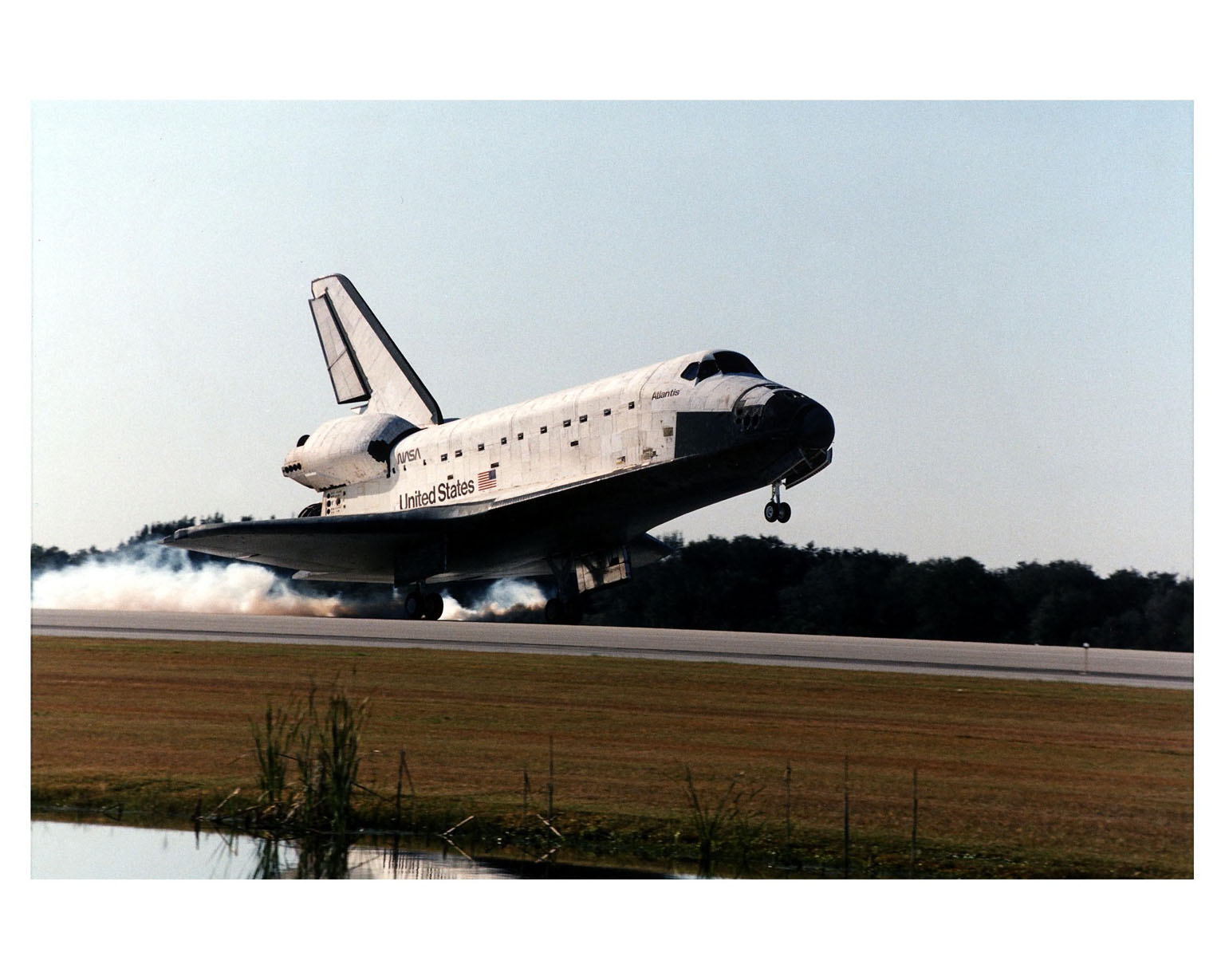 """The Space Shuttle orbiter Atlantis touches down on Runway 33 at 9:22:44 a.m. EST Jan. 22 to conclude the fifth Shuttle-Mir docking mission and return NASA astronaut John Blaha to Earth after four months in space. Blaha was replaced by STS-81 Mission Specialist Jerry Linenger during the five days of docked operations. At main gear touchdown, the STS-81 mission duration was 10 days, 4 hours, 55 minutes. This was the 34th KSC landing in Shuttle history. Mission Commander Michael A. Baker flew Atlantis to a perfect landing, with help from Pilot Brent W. Jett, Jr. Other returning STS-81 crew members are Mission Specialists John M. Grunsfeld, Peter J. K. """"Jeff"""" Wisoff and Marsha S. Ivins. Atlantis also brought back experiment samples from the Russian space station for analysis on Earth, along with Russian logistics equipment"""