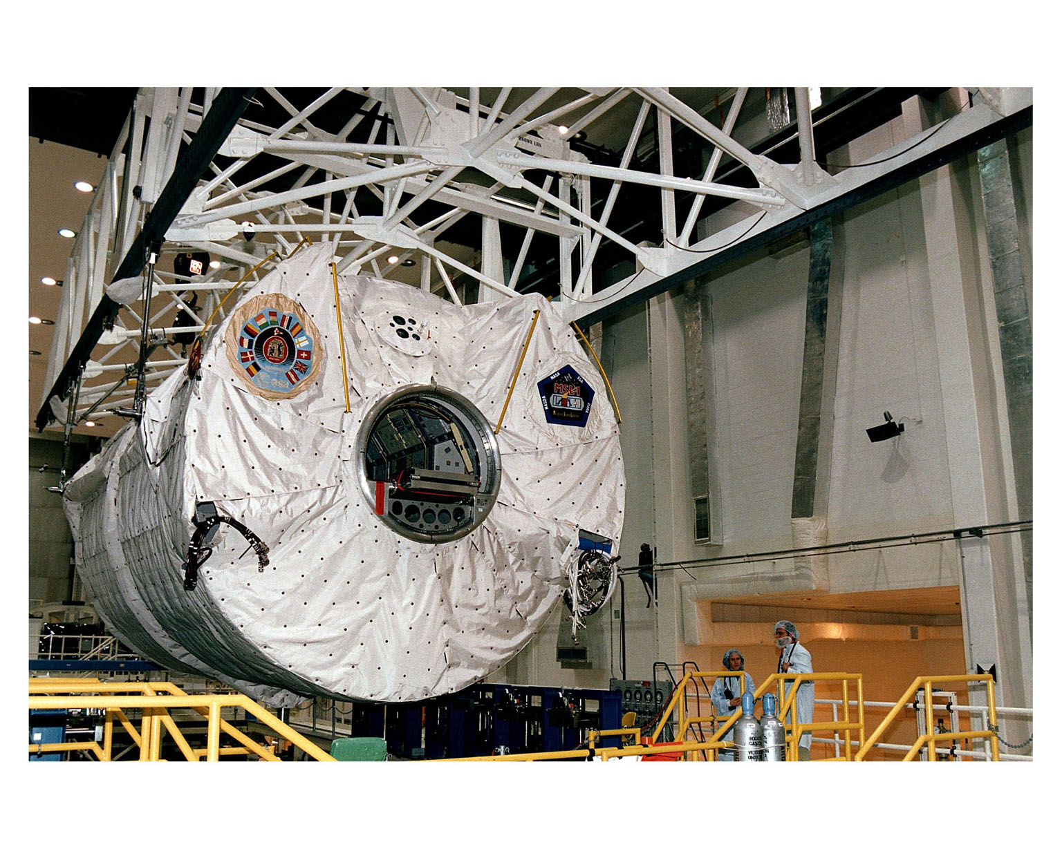 The Microgravity Science Laboratory-1 (MSL-1) Spacelab module is moved to be installed into a payload canister in the Operations and Checkout Building. Once in the canister, the MSL-1 will be transported to Orbiter Processing Bay 1 where it will be integrated into the payload bay of the Space Shuttle orbiter Columbia. During the scheduled 16-day STS-83 mission, the MSL-1 will be used to test some of the hardware, facilities and procedures that are planned for use on the International Space Station while the flight crew conducts combustion, protein crystal growth and materials processing experiments