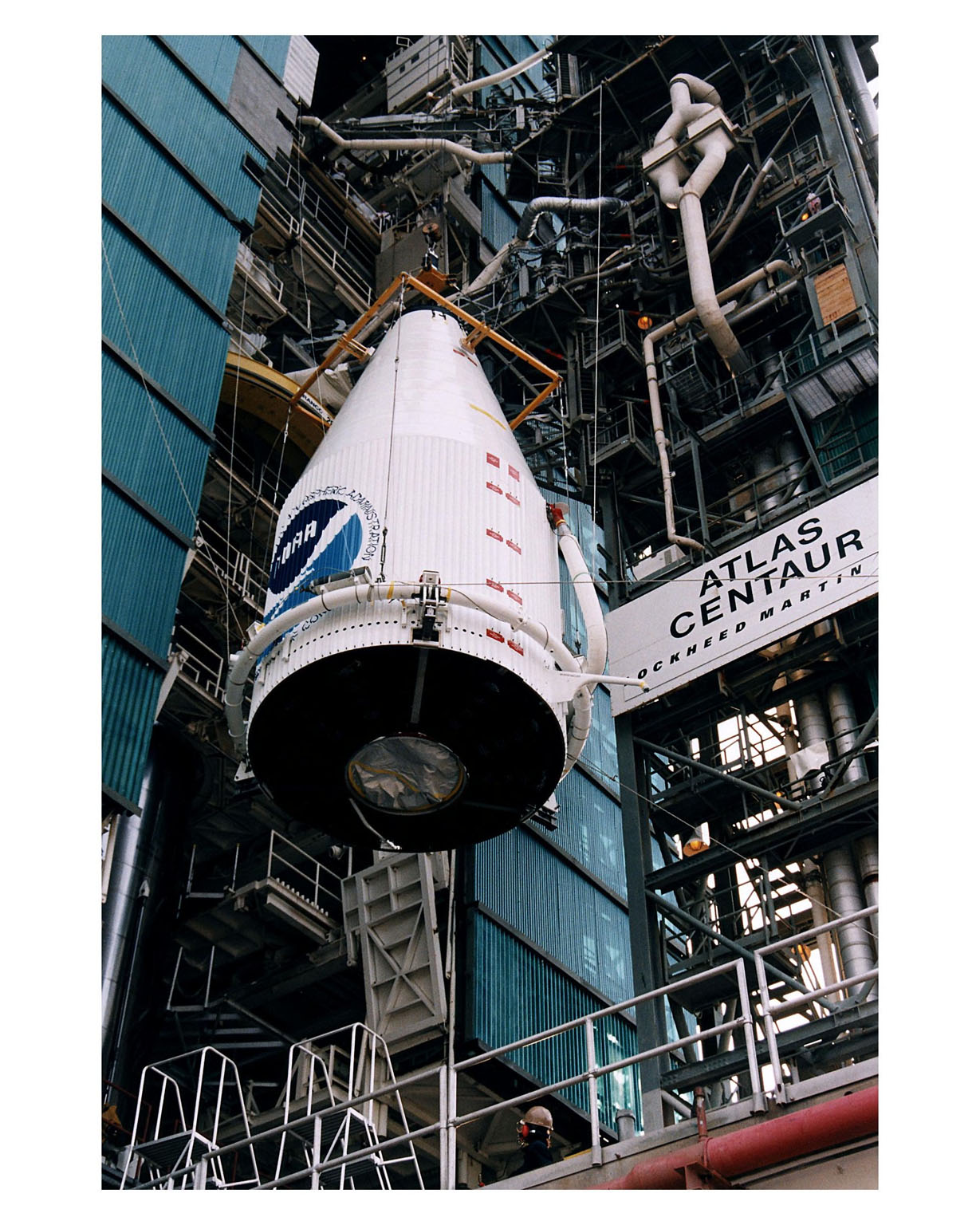 The Atlas 1 payload fairing with the encapsulated GOES-K advanced weather satellite is being lifted into position for mating to the Lockheed Martin Atlas 1 expendable launch vehicle (AC-79) at Launch Complex 36, Pad B, Cape Canaveral Air Station. GOES-K will be the third spacecraft to be launched in the advanced series of Geostationary Operational Environmental Satellites (GOES). The GOES satellites are owned and operated by the National Oceanic and Atmospheric Administration (NOAA); NASA manages the design, development and launch of the spacecraft. GOES-K is targeted for an April 24 launch [ http://www-pao.ksc.nasa.gov/kscpao/release/1997/63-97.htm ] during a launch window which extends from 1:50-3:09 a.m. EDT. Once in orbit, GOES-K will become GOES-10, joining GOES-8 and GOES-9 in space