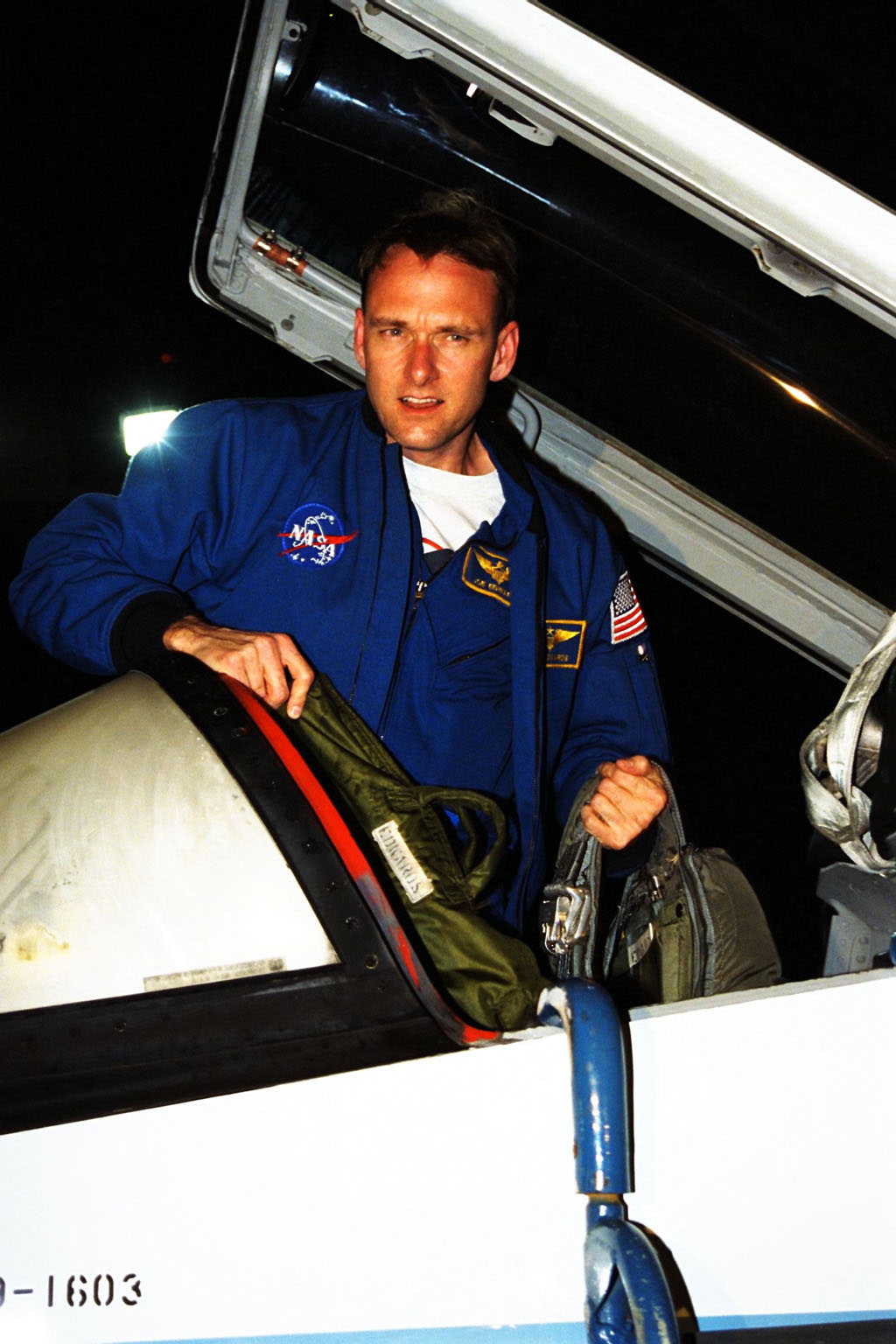 STS-89 Pilot Joe Edwards Jr., poses in his T-38 jet trainer after landing with other members of the flight crew at KSC?s Shuttle Landing Facility from NASA?s Johnson Space Center to begin Terminal Countdown Demonstration Test (TCDT) activities. The TCDT is held at KSC prior to each Space Shuttle flight to provide crews with the opportunity to participate in simulated countdown activities. Endeavour is targeted for launch of STS-89 on Jan. 22 at 9:48 p.m. EST, which will be the first mission of 1998 and the eighth to dock with Russia?s Mir Space Station. The mission is scheduled to last nine days