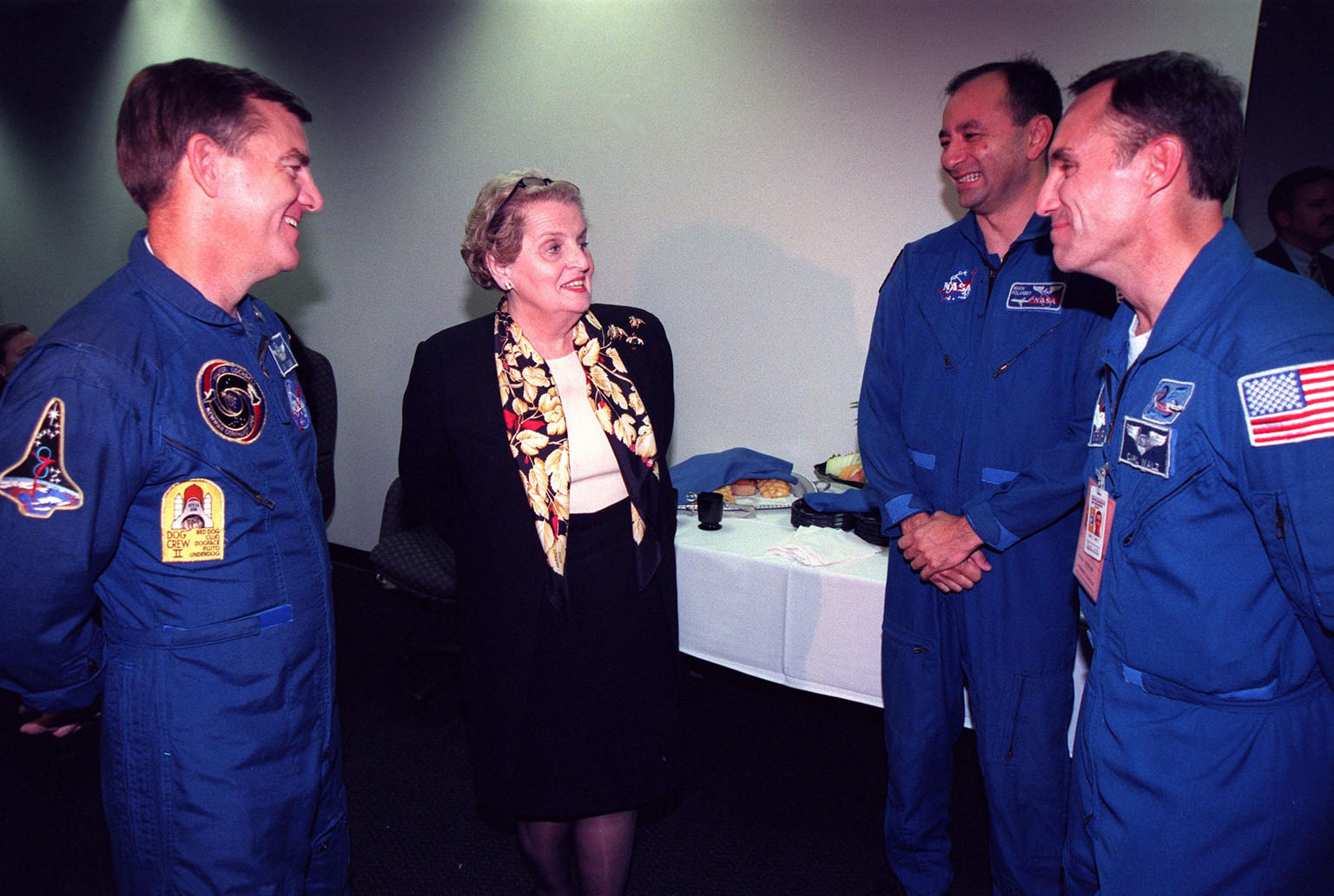 Following the successful launch of the STS-88 crew aboard Endeavour from Launch Pad 39A at 3:35:34 a.m. EST, U.S. Secretary of State Madeleine Albright (second from left) talks with astronauts (left to right) Jim Voss, Mark Polansky and Carl Walz. STS-88 is the first U.S. mission dedicated to the assembly of the International Space Station (ISS). Voss is a member of the STS-100 crew which will be the eighth ISS assembly mission. Polansky is slated to fly on STS-98 which will be the sixth ISS assembly mission. Walz is currently assigned to fly on the ISS on the fourth long duration crew