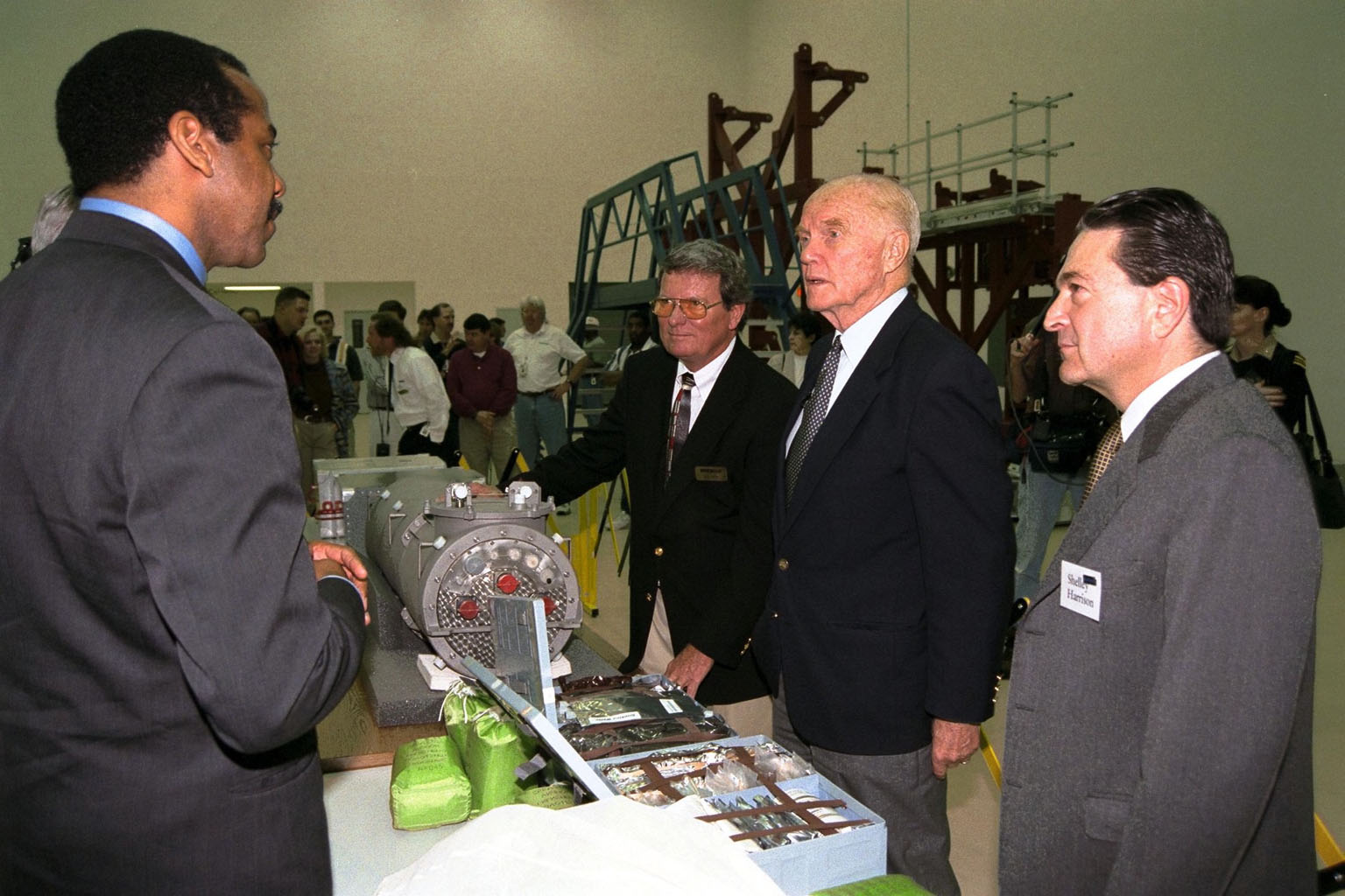 Ohio Senator John Glenn, second from right, enjoys a tour of the SPACEHAB Payload Processing Facility in Cape Canaveral. Joining Senator Glenn are, left to right, Dr. Bernard Harris, SPACEHAB vice president, microgravity and life sciences; Dale Steffey, SPACEHAB vice president, operations; and Dr. Shelley Harrison, SPACEHAB chairman and chief executive officer. Senator Glenn arrived at KSC on Jan. 20 to tour KSC operational areas and to view the launch of STS-89 later this week. Glenn, who made history in 1962 as the first American to orbit the Earth, completing three orbits in a five-hour flight aboard Friendship 7, will fly his second space mission aboard Space Shuttle Discovery this October. Glenn is retiring from the Senate at the end of this year and will be a payload specialist aboard STS-95