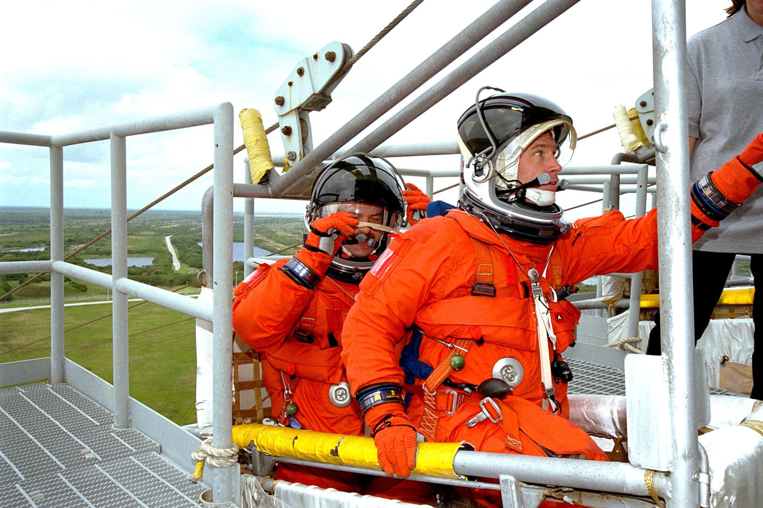Members of the STS-90 crew participate in mock emergency egress activities during the Terminal Countdown Demonstration Test (TCDT) at KSC's Launch Pad 39B. The TCDT is held at KSC prior to each Space Shuttle flight to provide crews with the opportunity to participate in simulated countdown activities. The STS-90 crew members shown here are Commander Richard Searfoss (front) and Pilot Scott Altman. Columbia is targeted for launch of STS-90 on April 16 at 2:19 p.m. EDT and will be the second mission of 1998. The mission is scheduled to last nearly 17 days
