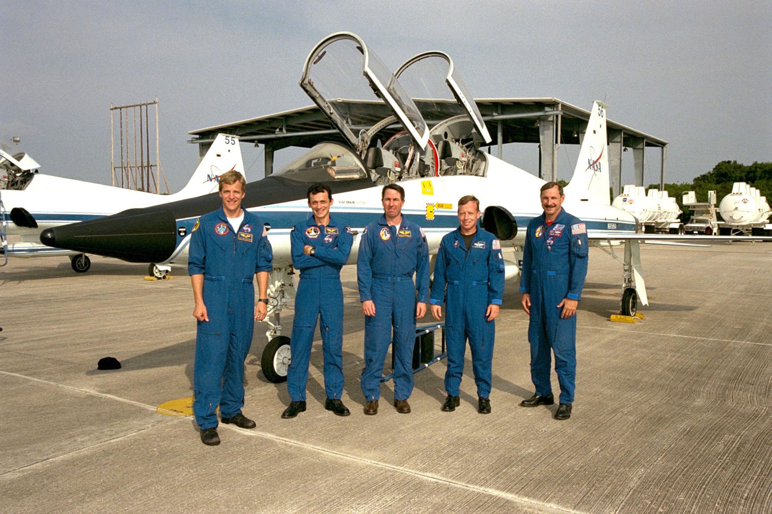 Members of the STS-95 crew pose in front of one of the T-38 jet aircraft that brought them to the Shuttle Landing Facility at KSC. From left, the members are Mission Specialist Scott E. Parazynski, M.D.; Pedro Duque of Spain, representing the European Space Agency (ESA); Mission Specialist Stephen K. Robinson, Ph.D.; Pilot Steven W. Lindsey; and Commander Curtis L. Brown Jr. The crew is participating in a familiarization tour of the SPACEHAB module and the equipment that will fly with them on the Space Shuttle Discovery scheduled to launch Oct. 29, 1998. The mission includes research payloads such as the Spartan solar-observing deployable spacecraft, the Hubble Space Telescope Orbital Systems Test Platform, the International Extreme Ultraviolet Hitchhiker, as well as the SPACEHAB single module with experiments on space flight and the aging process