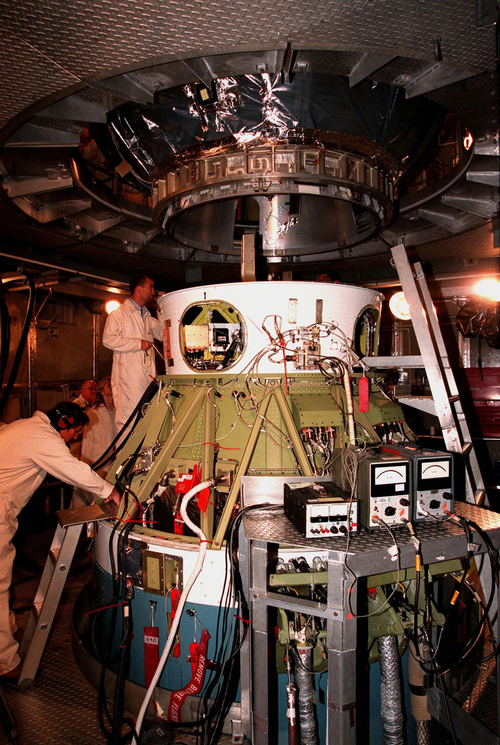 Workers inside the launch tower at Pad 17-A, Cape Canaveral Air Station, watch as the third stage of a Boeing Delta II rocket is lowered for mating with the second stage below it. The Stardust spacecraft, above it out of sight, is connected to the rocket's third stage. Stardust, targeted for liftoff on Feb. 6, is destined for a close encounter with the comet Wild 2 in January 2004. Using a silicon-based substance called aerogel, Stardust will capture comet particles flying off the nucleus of the comet. The spacecraft also will bring back samples of interstellar dust. These materials consist of ancient pre-solar interstellar grains and other remnants left over from the formation of the solar system. Scientists expect their analysis to provide important insights into the evolution of the sun and planets and possibly into the origin of life itself. The collected samples will return to Earth in a sample return capsule to be jettisoned as Stardust swings by Earth in January 2006