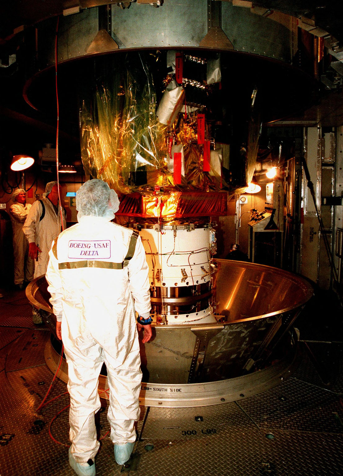The protective canister is removed from around the Stardust spacecraft at Launch Pad 17-A, Cape Canaveral Air Station. Preparations continue for liftoff of the Boeing Delta II rocket carrying Stardust on Feb. 6. Stardust is destined for a close encounter with the comet Wild 2 in January 2004. Using a silicon-based substance called aerogel, Stardust will capture comet particles flying off the nucleus of the comet. The spacecraft also will bring back samples of interstellar dust. These materials consist of ancient pre-solar interstellar grains and other remnants left over from the formation of the solar system. Scientists expect their analysis to provide important insights into the evolution of the sun and planets and possibly into the origin of life itself. The collected samples will return to Earth in a sample return capsule to be jettisoned as Stardust swings by Earth in January 2006