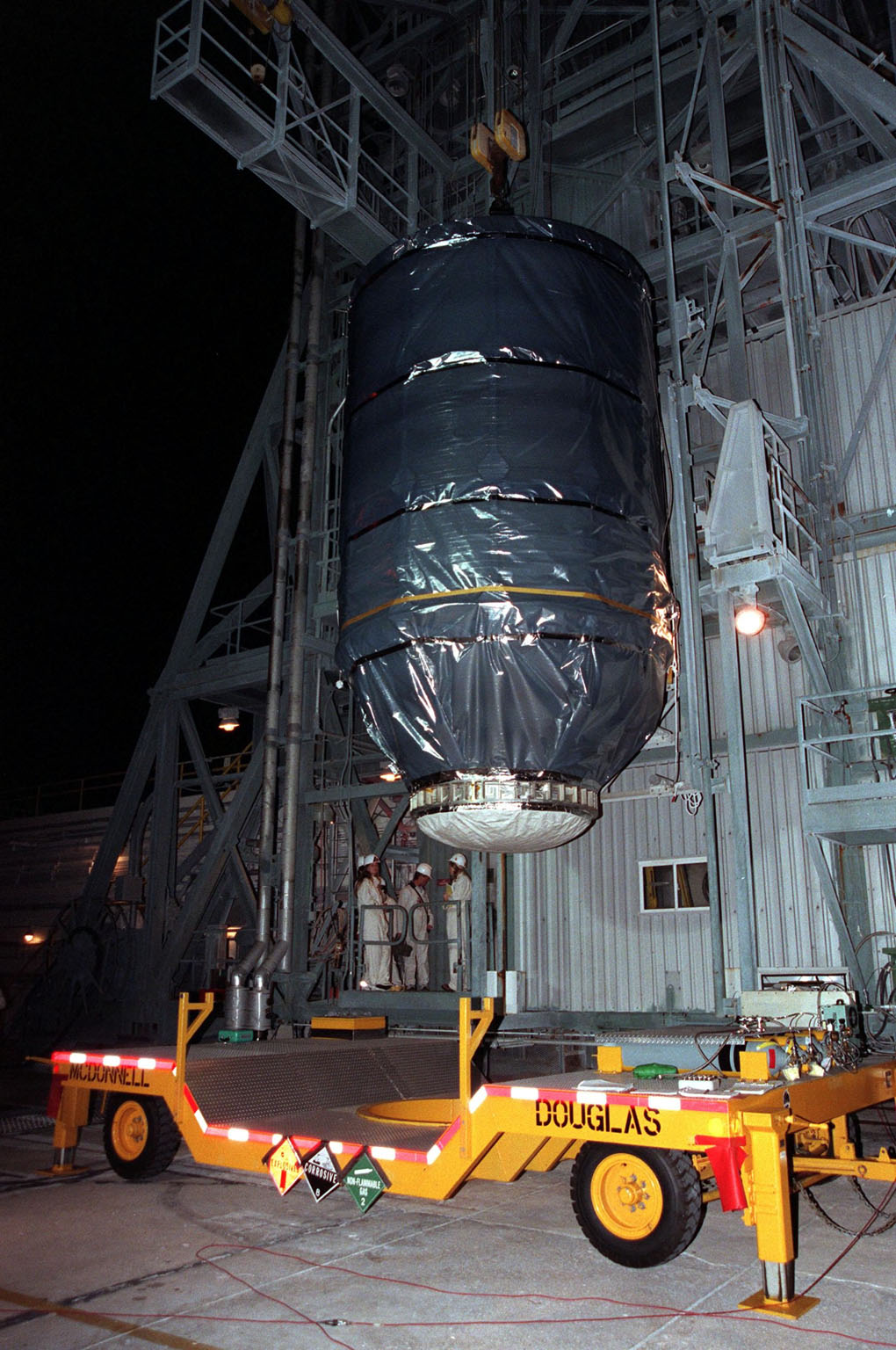 At Launch Pad 17-A, Cape Canaveral Air Station, the Stardust spacecraft, attached to the third stage of a Boeing Delta II rocket, is lifted up the launch tower. The second and third stages of the rocket will be mated next as preparations continue for liftoff on Feb. 6. Stardust is destined for a close encounter with the comet Wild 2 in January 2004. Using a silicon-based substance called aerogel, Stardust will capture comet particles flying off the nucleus of the comet. The spacecraft also will bring back samples of interstellar dust. These materials consist of ancient pre-solar interstellar grains and other remnants left over from the formation of the solar system. Scientists expect their analysis to provide important insights into the evolution of the sun and planets and possibly into the origin of life itself. The collected samples will return to Earth in a sample return capsule to be jettisoned as Stardust swings by Earth in January 2006